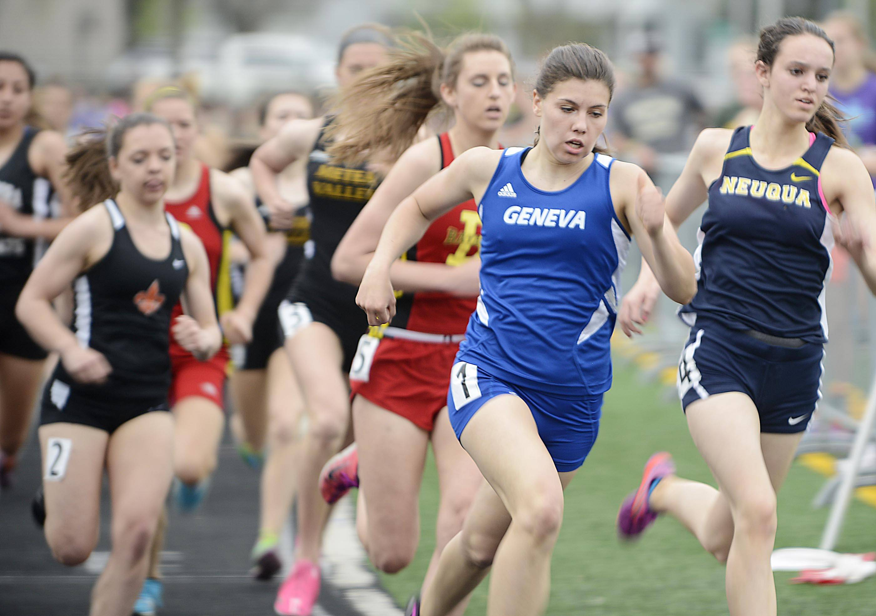 John Starks/jstarks@dailyherald.com ¬ Geneva's Kathryn Adelman takes an outside lane around turn one in on her way to a victory in the 800 meter run Thursday at the Upstate Eight Conference girls track meet at Geneva High School.