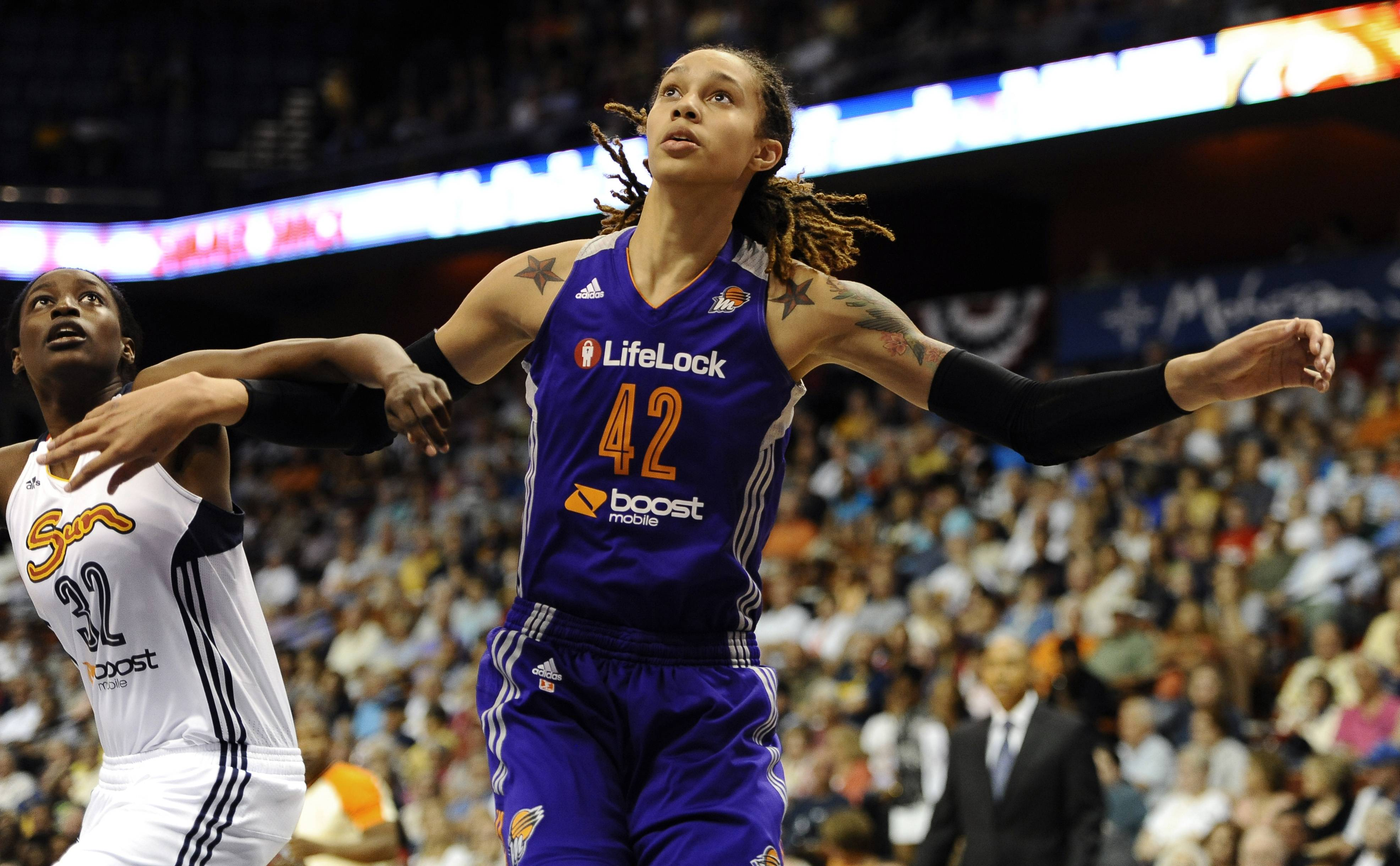 FILE - In this June 29, 2013 file photo, Connecticut Sun's Kalana Greene, left, and Phoenix Mercury's Brittney Griner eye a rebound during the first half of a WNBA basketball game in Uncasville, Conn. The WNBA is launching a campaign to market specifically to the gay, lesbian, bisexual and transgendered community. It's the first league to design such a campaign. Griner, who is one of a handful of WNBA athletes who have publicly identified themselves as lesbian, was happy the league was embracing the community.