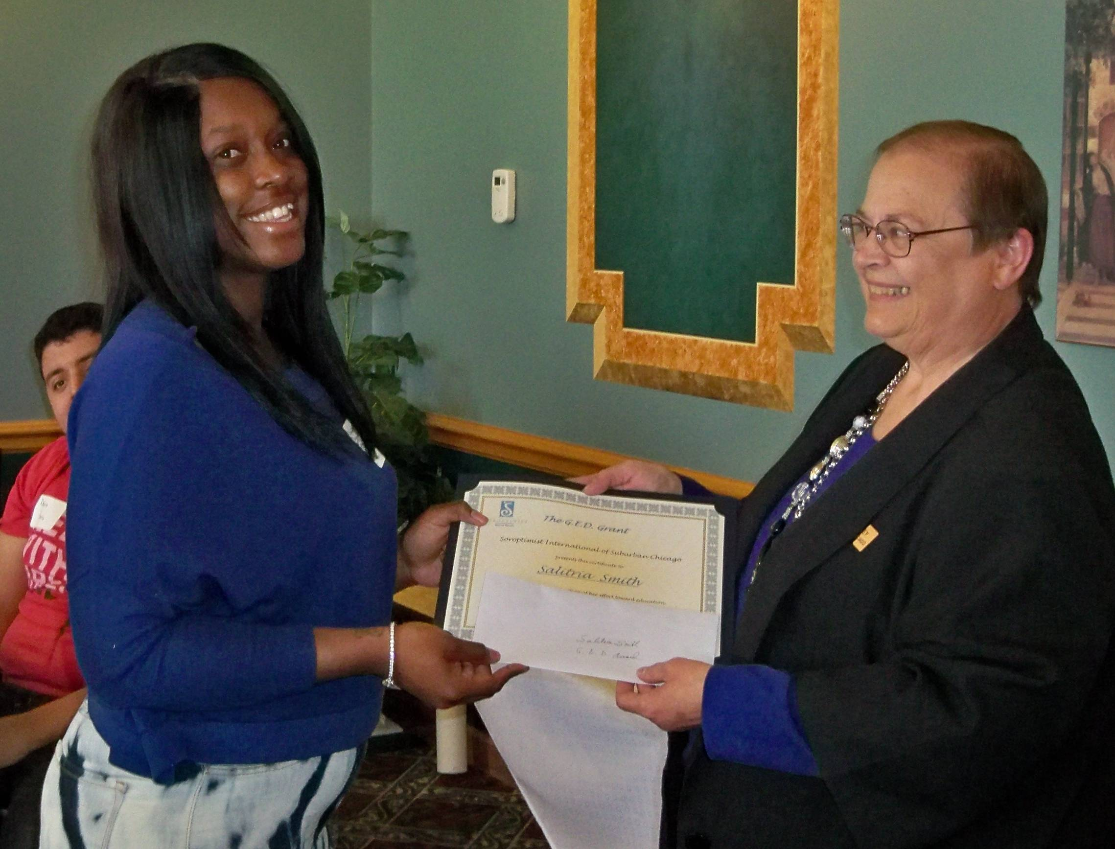 Salitria Smith (left) of Aurora accepting the SISC GED Grant from Diane Kegley, President - SI of Suburban ChicagoDiane Kegley