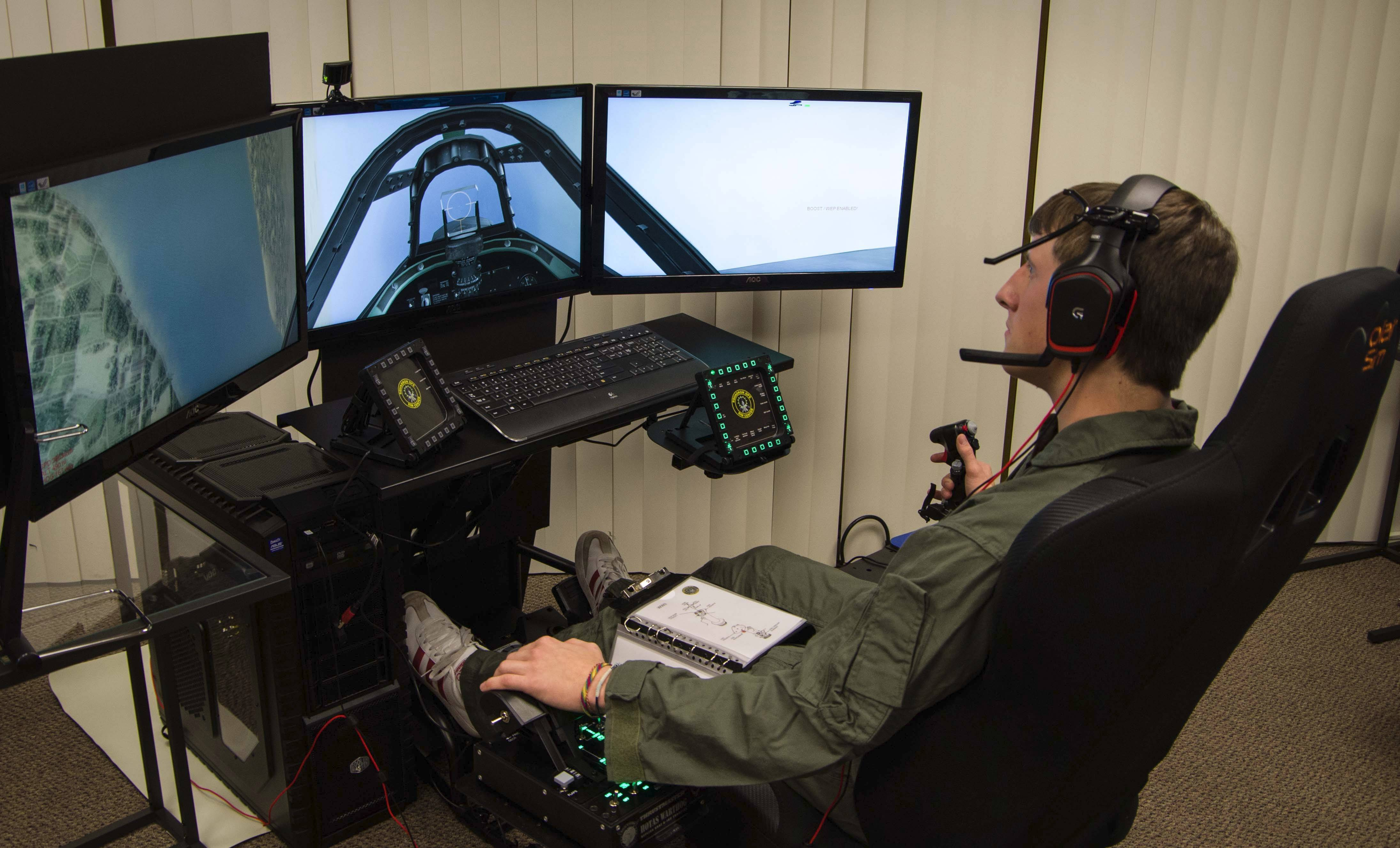 Kyle Jachcinski, a staff member of the Squadron Ops Sim Center at the Aurora Airport in Sugar Grove, tries out one of the fighter pilot simulators.