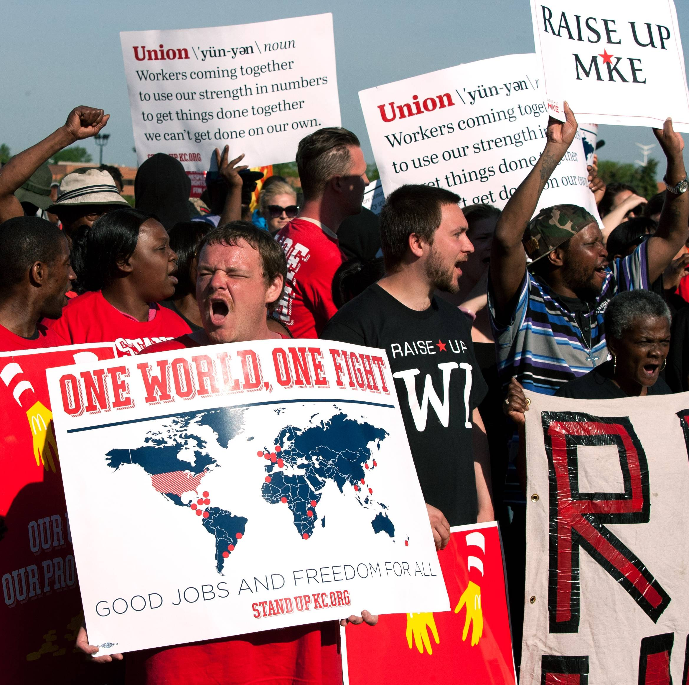 Protesters call for higher wages for fast-food workers outside McDonald's headquarters at an annual shareholder meeting in Oak Brook Thursday.