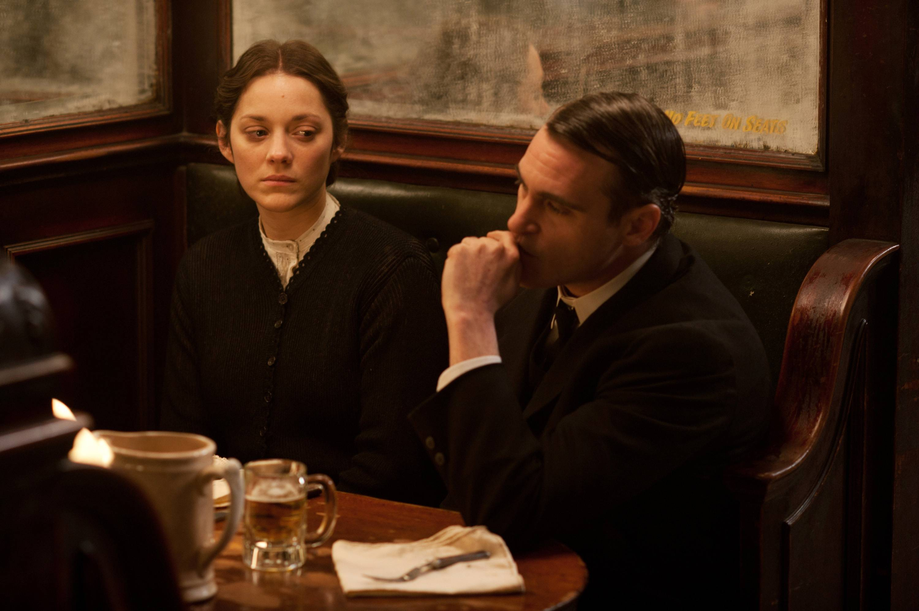 "Ewa (Marion Cotillard) relies on the unsavory help of Bruno (Joaquin Phoenix) when she arrives in America in ""The Immigrant."""