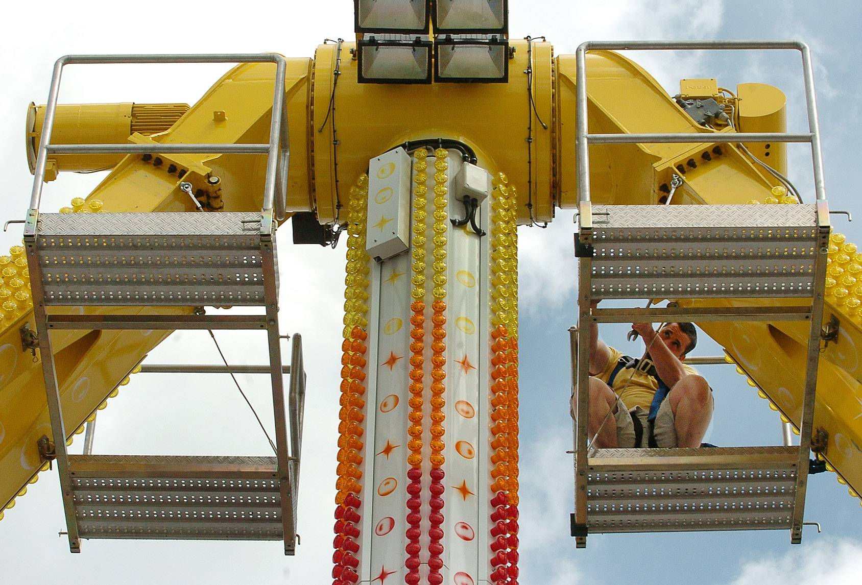 Vincent Bayman tightens bolts on the Freakout ride, preparing for Thursday's opening of the Mount Prospect Jaycees Memorial Day Carnival. The event, returning from a three-year hiatus, is being held in the parking lot of the Mount Prospect Plaza at Central and Rand roads.