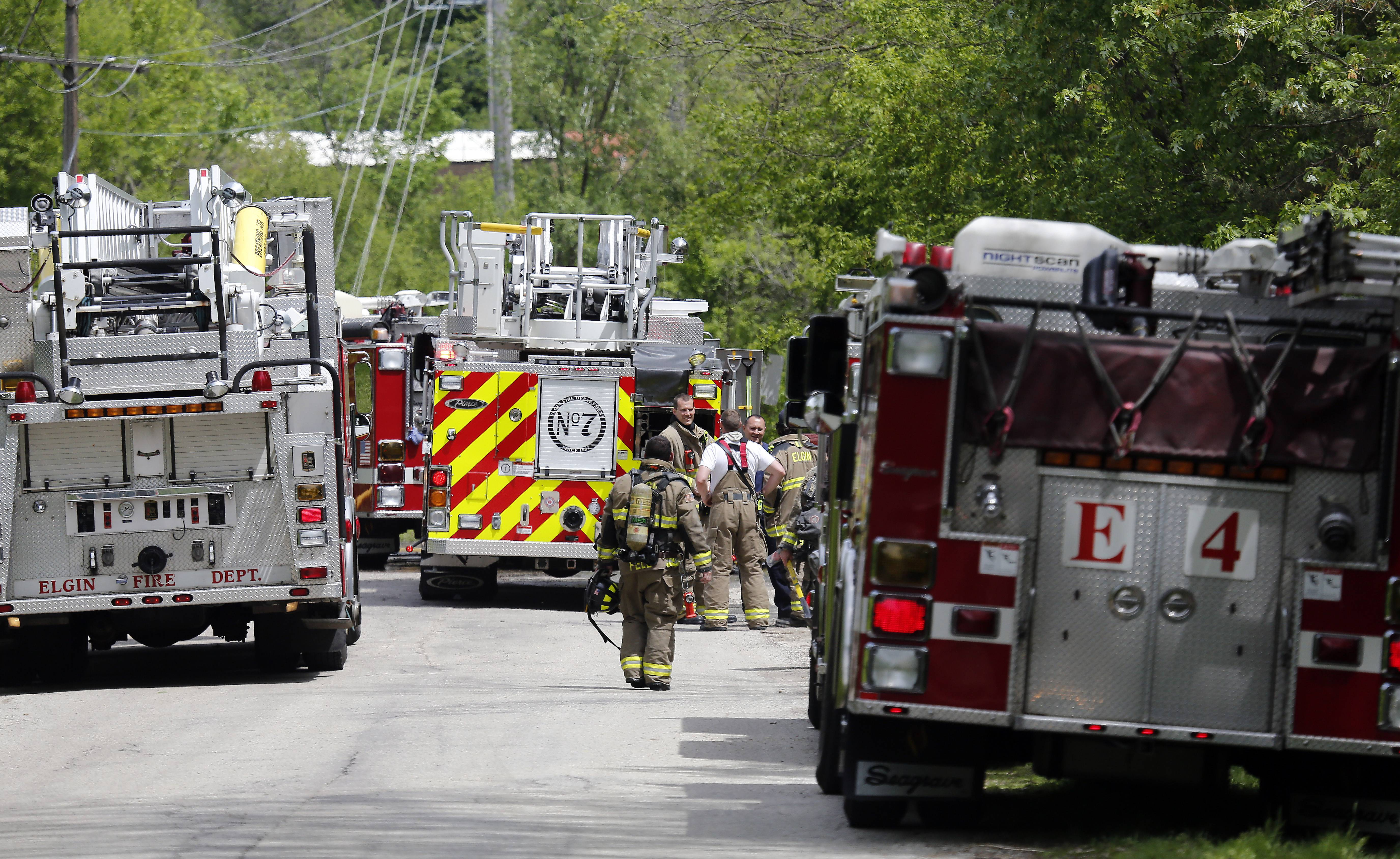 Fire trucks surround a home on Jerusha Avenue in Elgin Thursday afternoon as firefighters tried to put out a house fire. No one was injured, but two pets were lost in the blaze that left the house uninhabitable.