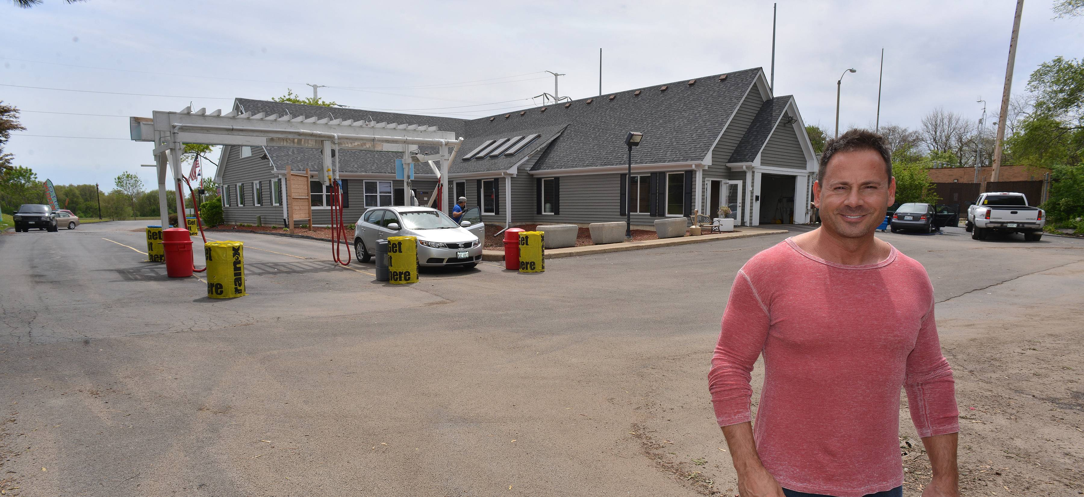 Owner Bill Loumbardias stands in the area where used cars will be offered for sale at the Finish Line Car Wash on 75th Street near Naper Boulevard in Naperville. A maximum of 28 cars will be allowed on the property at any one time behind the existing car wash.