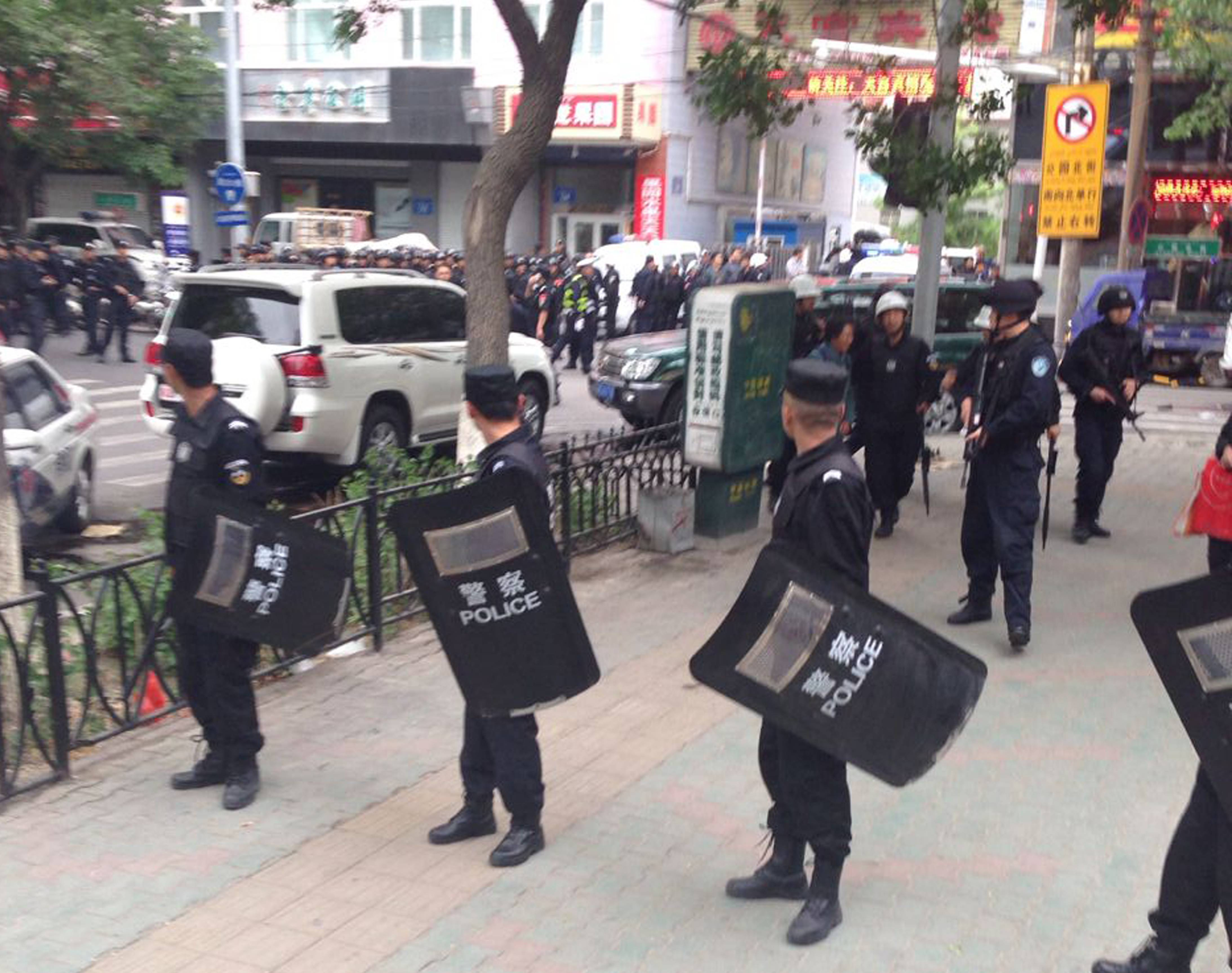 Attackers crashed a pair of vehicles and tossed explosives in an attack Thursday near an open air market in the capital of China's volatile northwestern region of Xinjiang, state media reported.