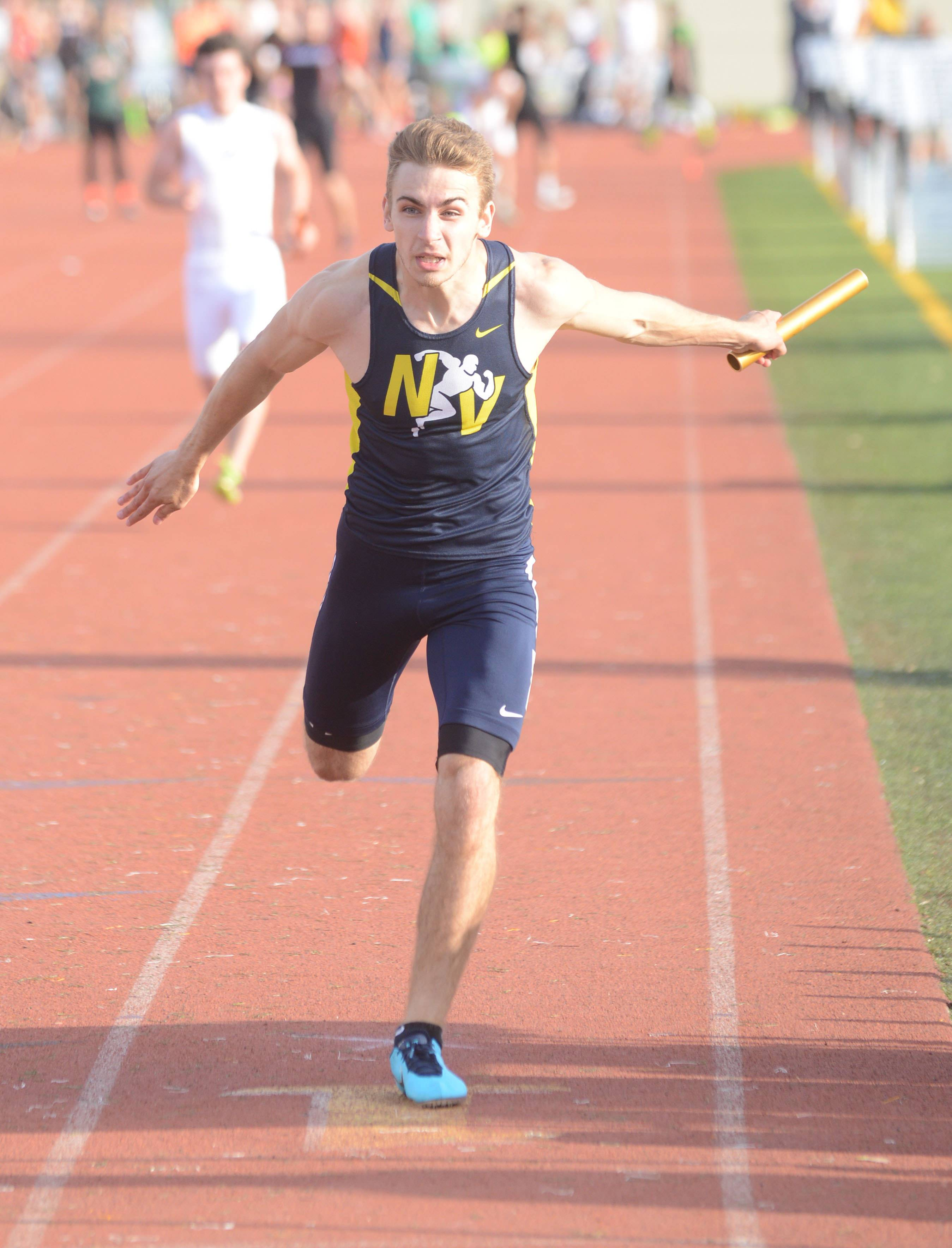 Nick Rafacz of Neuqua Valley takes part in the 4x200 relay during the Class 3A Joliet West boys track sectional Thursday.
