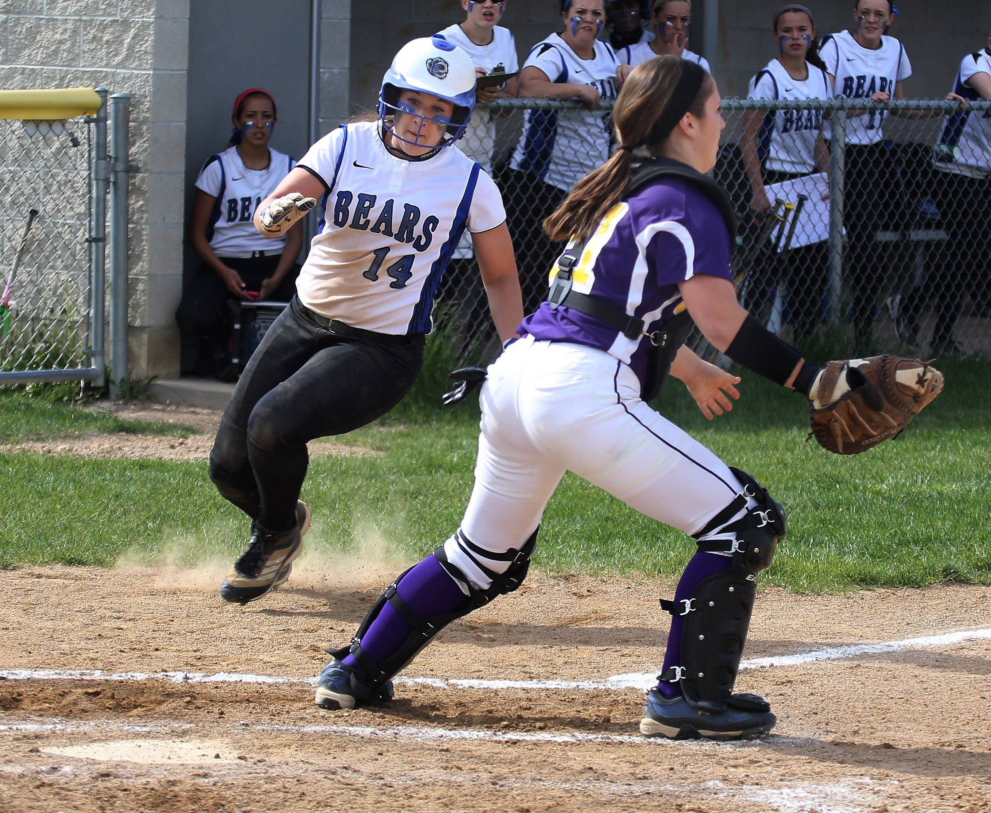 Lake Zurich's Maria Schroeder scores past Wauconda catcher Taylor McCarthy in the first inning of Thursday's NSC championship game at Wauconda.