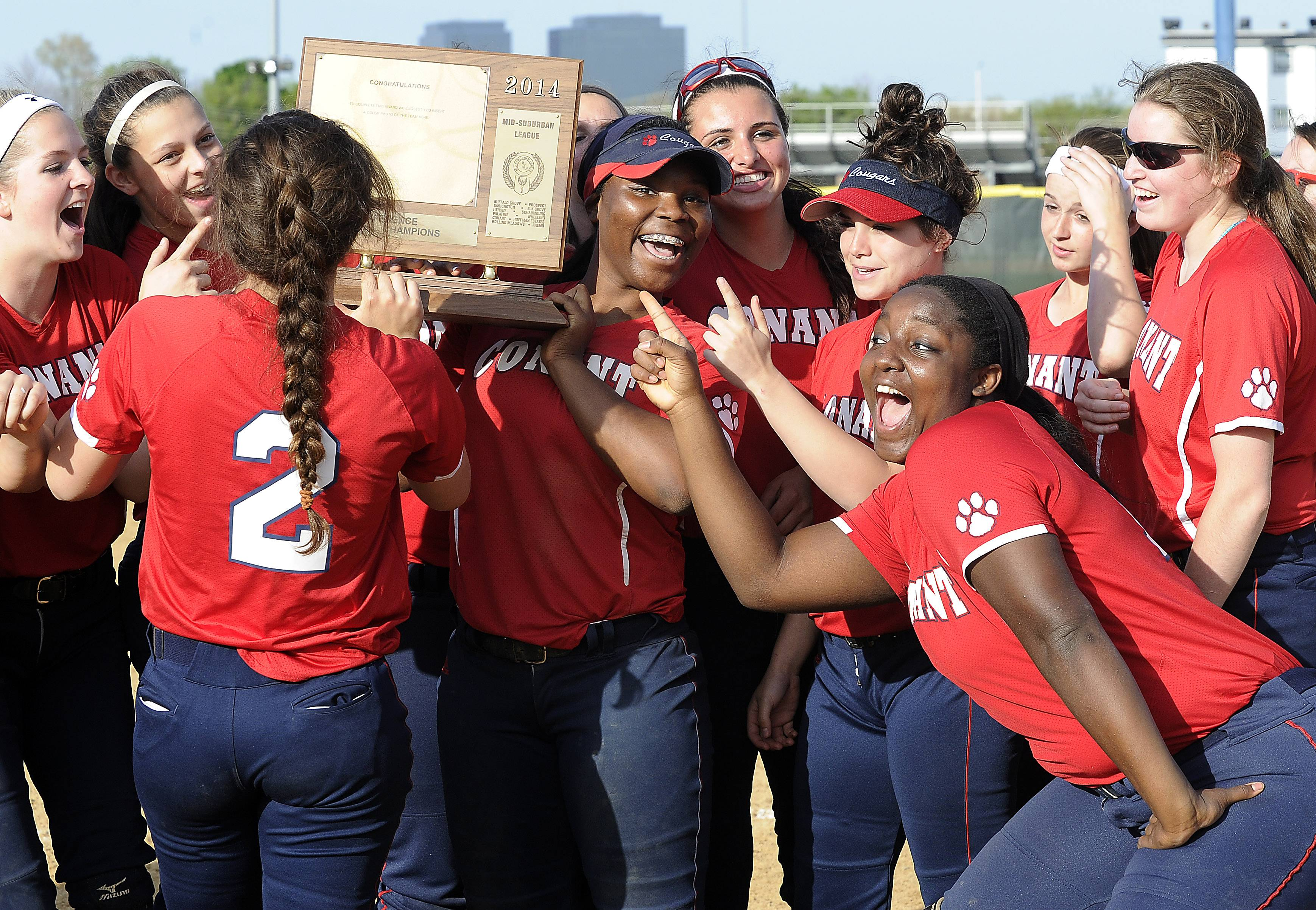 Conant's softball team celebrates its 3-0 win over Buffalo Grove in the Mid-Suburban League championship game Thursday in Hoffman Estates.