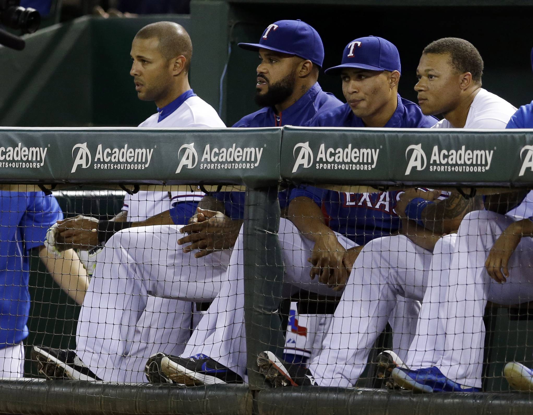 Texas Rangers' Alex Rios, from left, Prince Fielder, Leonys Martin, and Michael Choice, right, watch play in the sixth inning of a baseball game against the Seattle Mariners, Tuesday, May 20, 2014, in Arlington, Texas. (AP Photo/Tony Gutierrez )