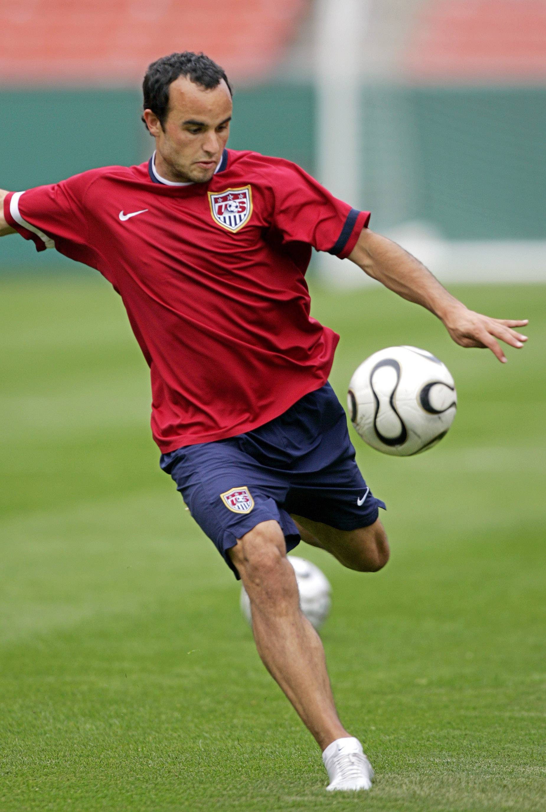 United States midfielder Landon Donovan takes a shot during practice at Cleveland Browns Stadium Thursday, May 25, 2006, in Cleveland. The USA plays Venezuela in a friendly match Friday night in preparation for the 2006 World Cup. (AP Photo/Mark Duncan)