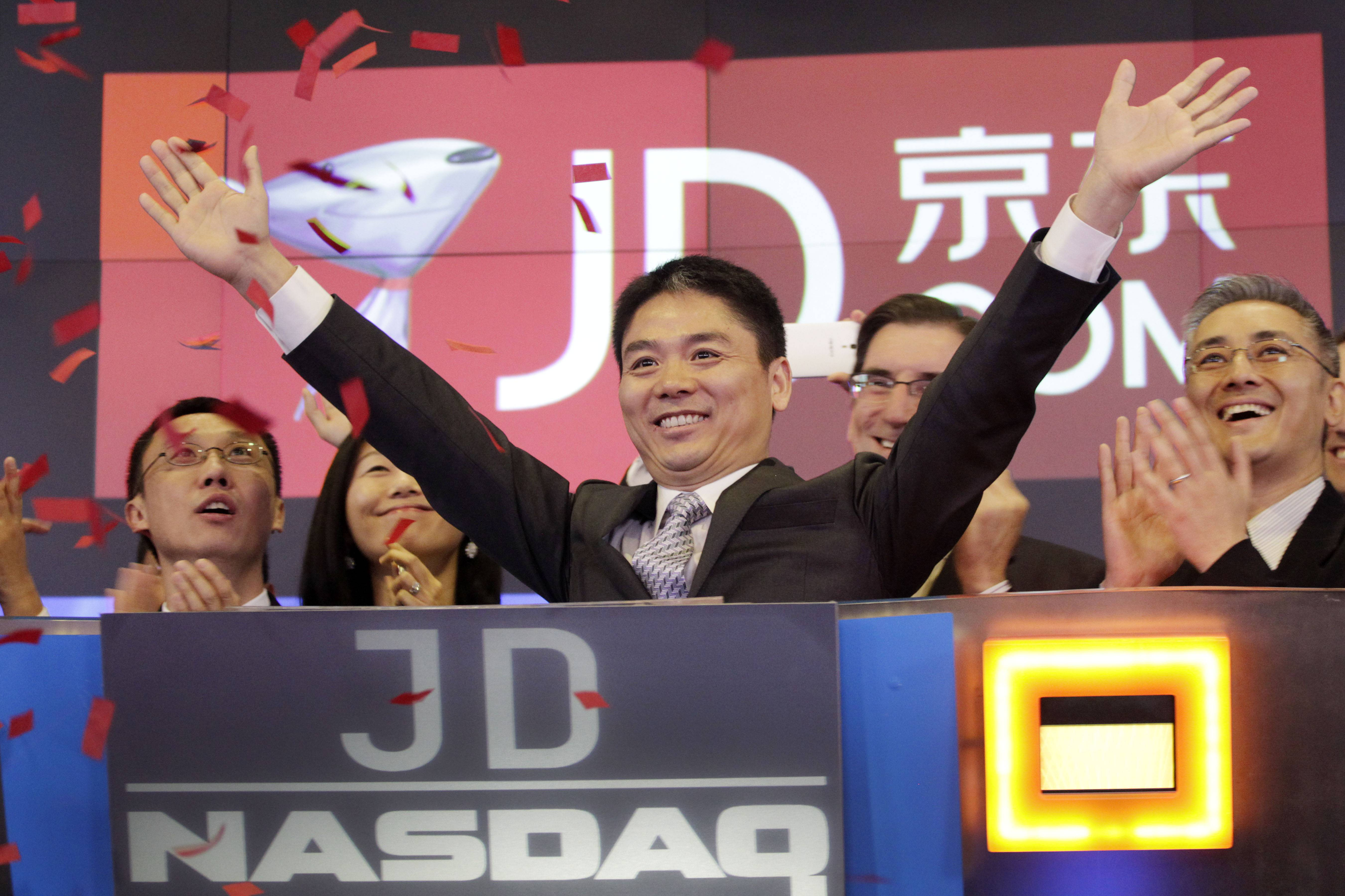 Qiangdong Liu, CEO of JD.com, raises his arms to celebrate the IPO for his company at the Nasdaq MarketSite, Thursday in New York. JD.com, China's No. 2 e-commerce service, is headquartered in Beijing.