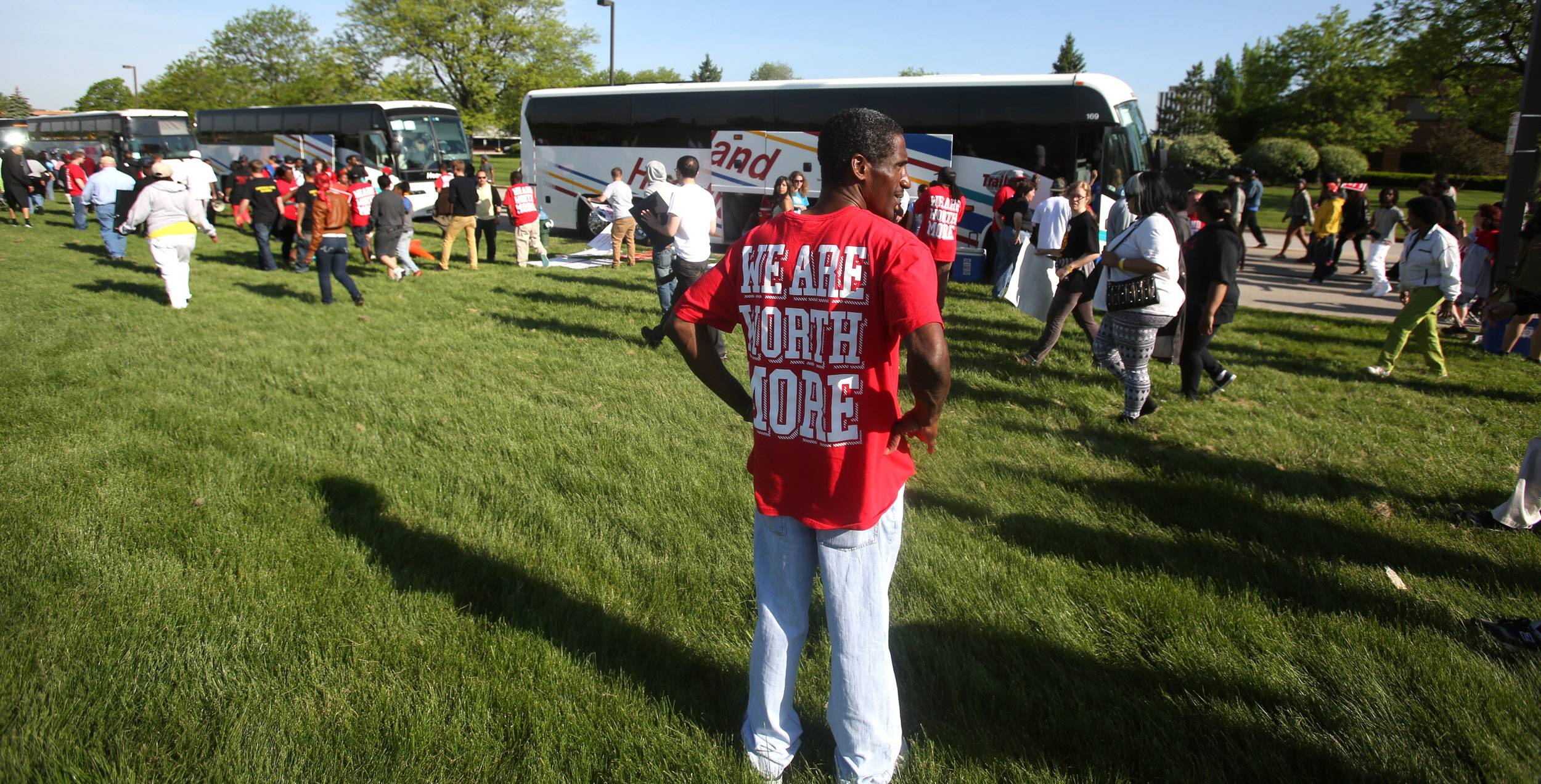 Protesters head back to their buses following a demonstration for higher wages outside McDonald's headquarters during an annual shareholder meeting in Oak Brook.