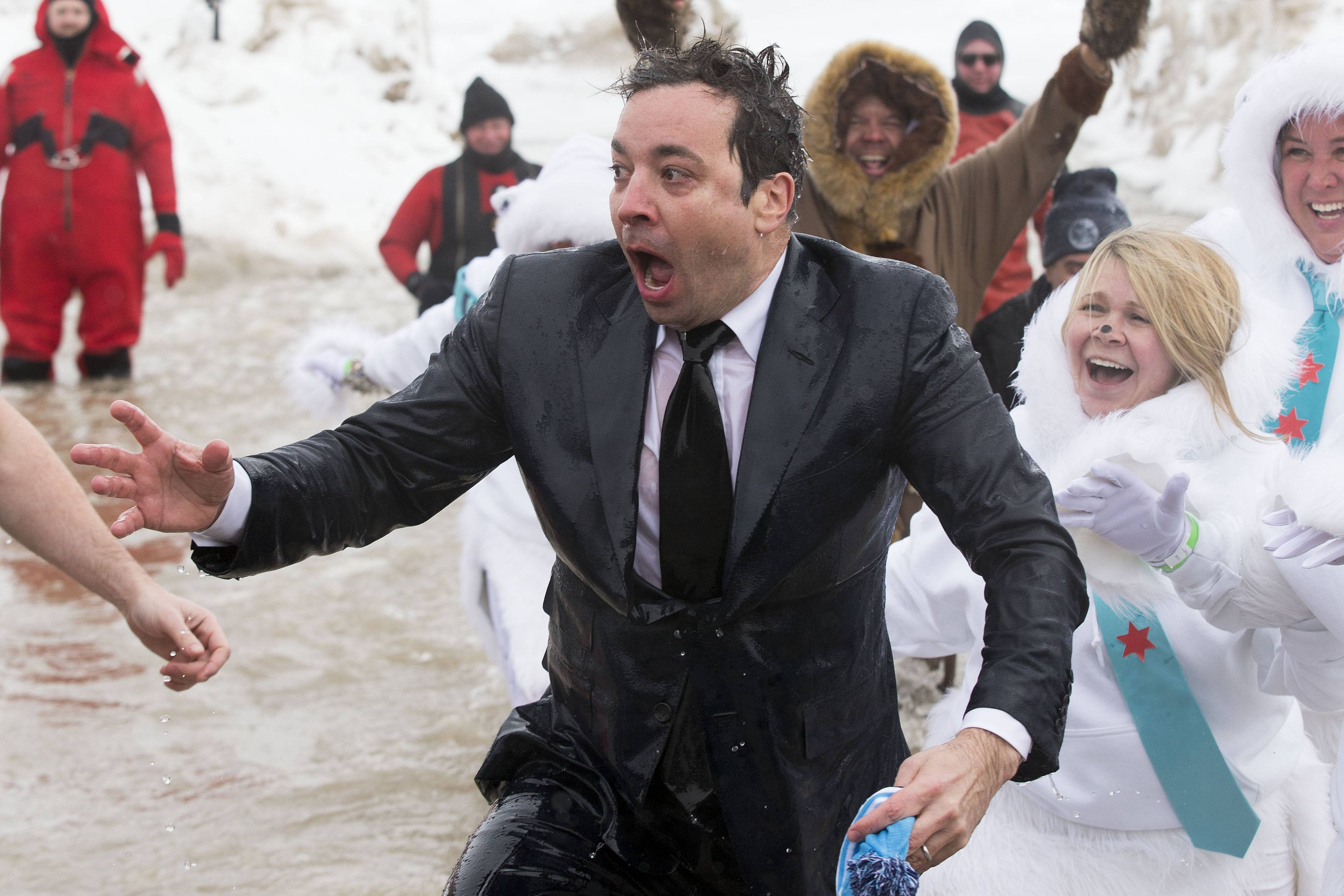 "Jimmy Fallon, host of ""The Tonight Show,"" exits the icy waters of Lake Michigan during the ""Polar Plunge"" in Chicago."
