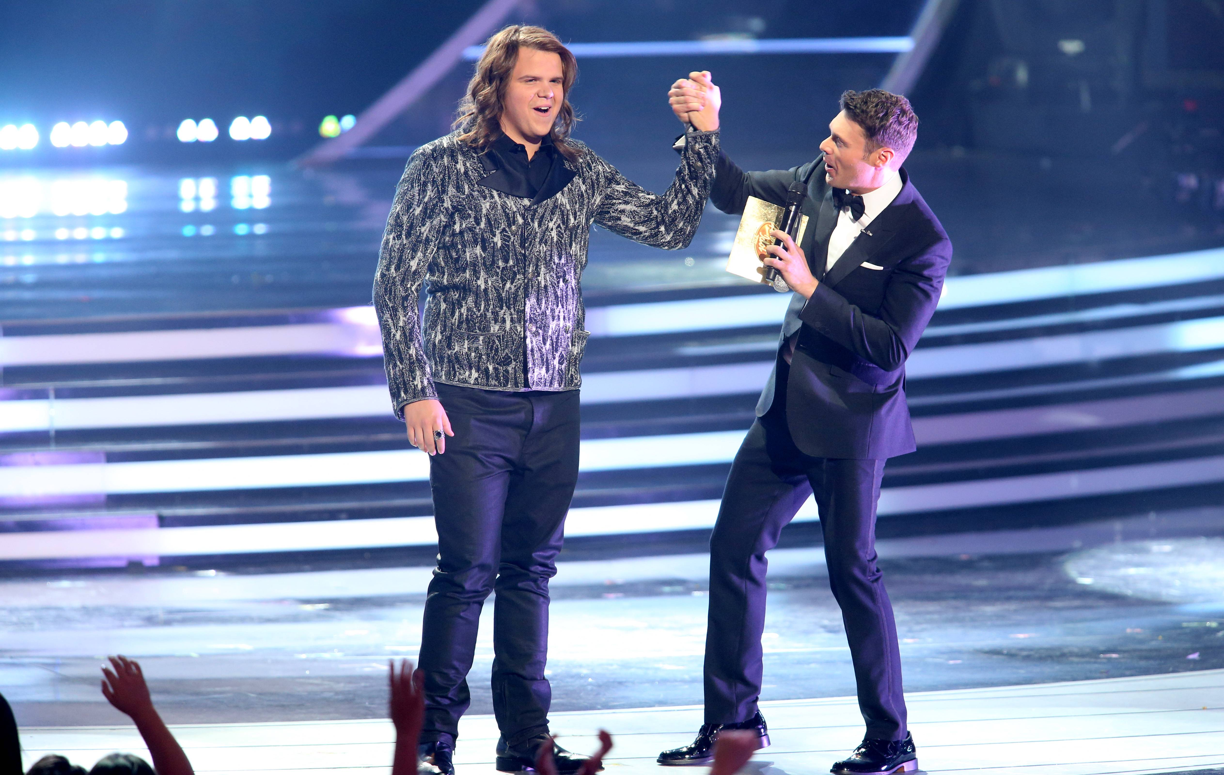 "Ryan Seacrest, right, announces Caleb Johnson the winner of season 13 of Fox's ""American Idol"" Wednesday."