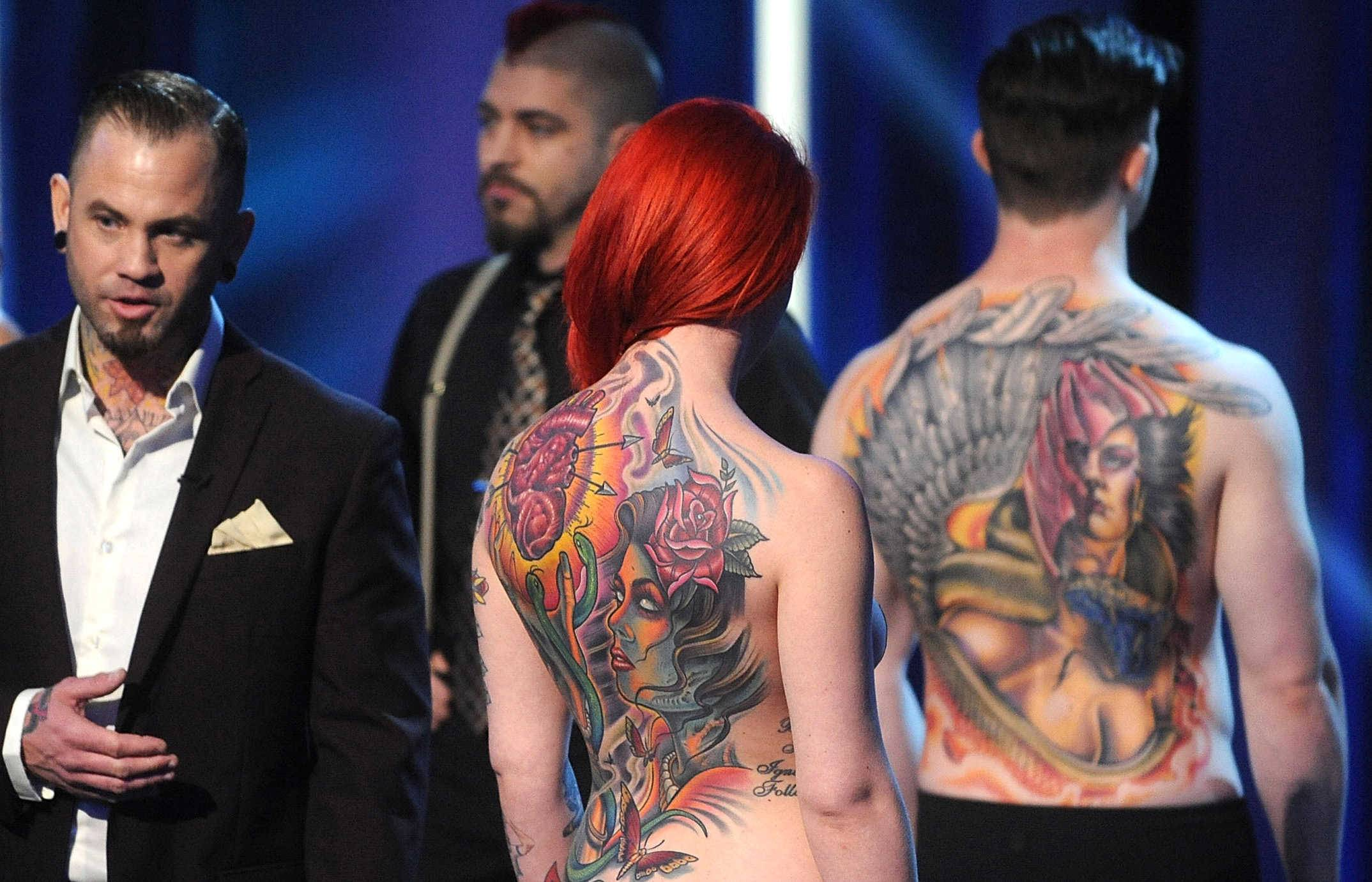 "Tattoo artist Scott Marshall of Roselle, left, was named the winner of Spike TV's ""Ink Master"" Season 4 live finale on Tuesday."