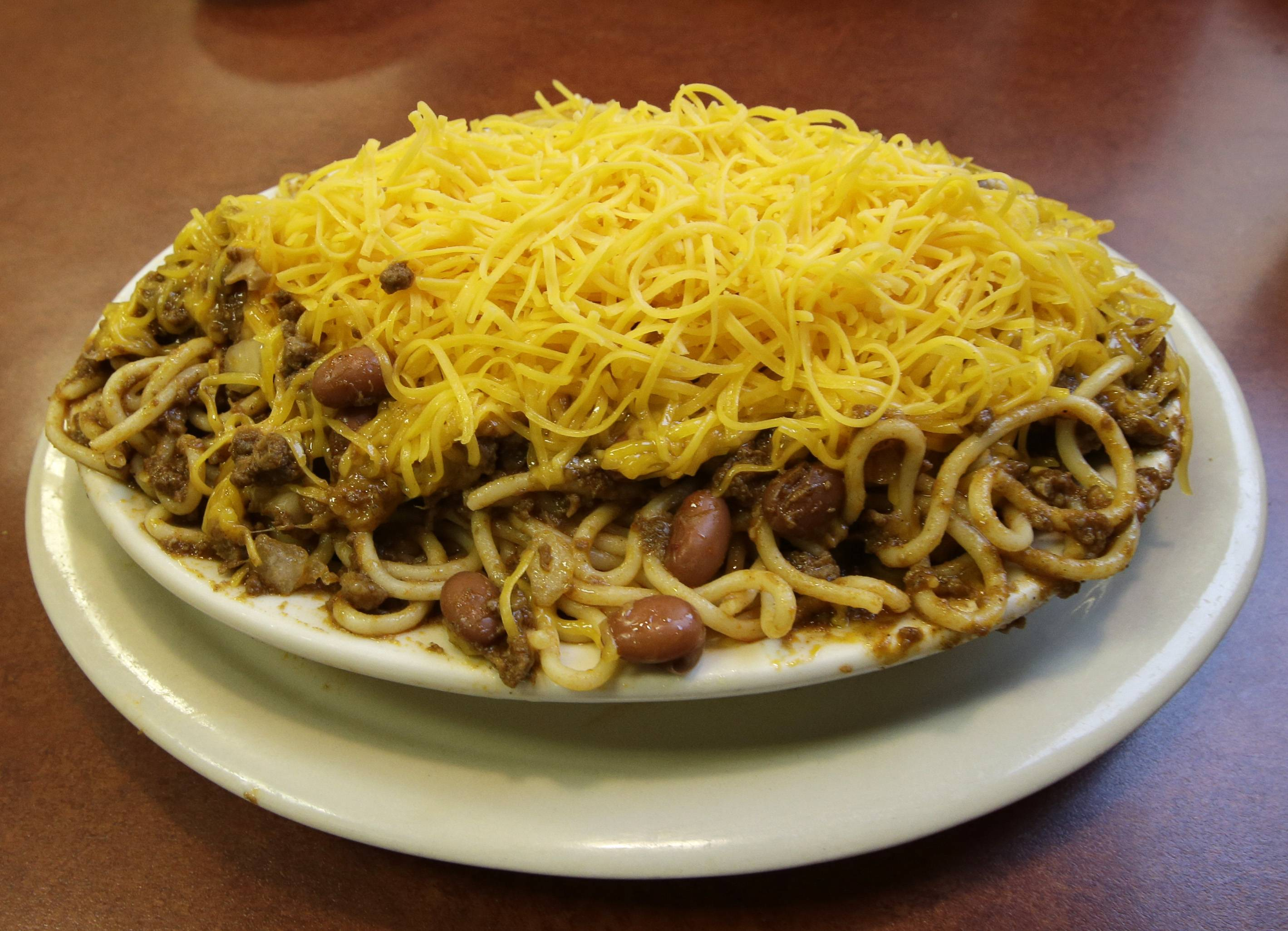 Cincinnati is known for its quirky version of chili, a pile of sweet, cinnamon-flavored meat sauce served over a plate of spaghetti noodles and topped with a heaping mound of shredded cheddar.