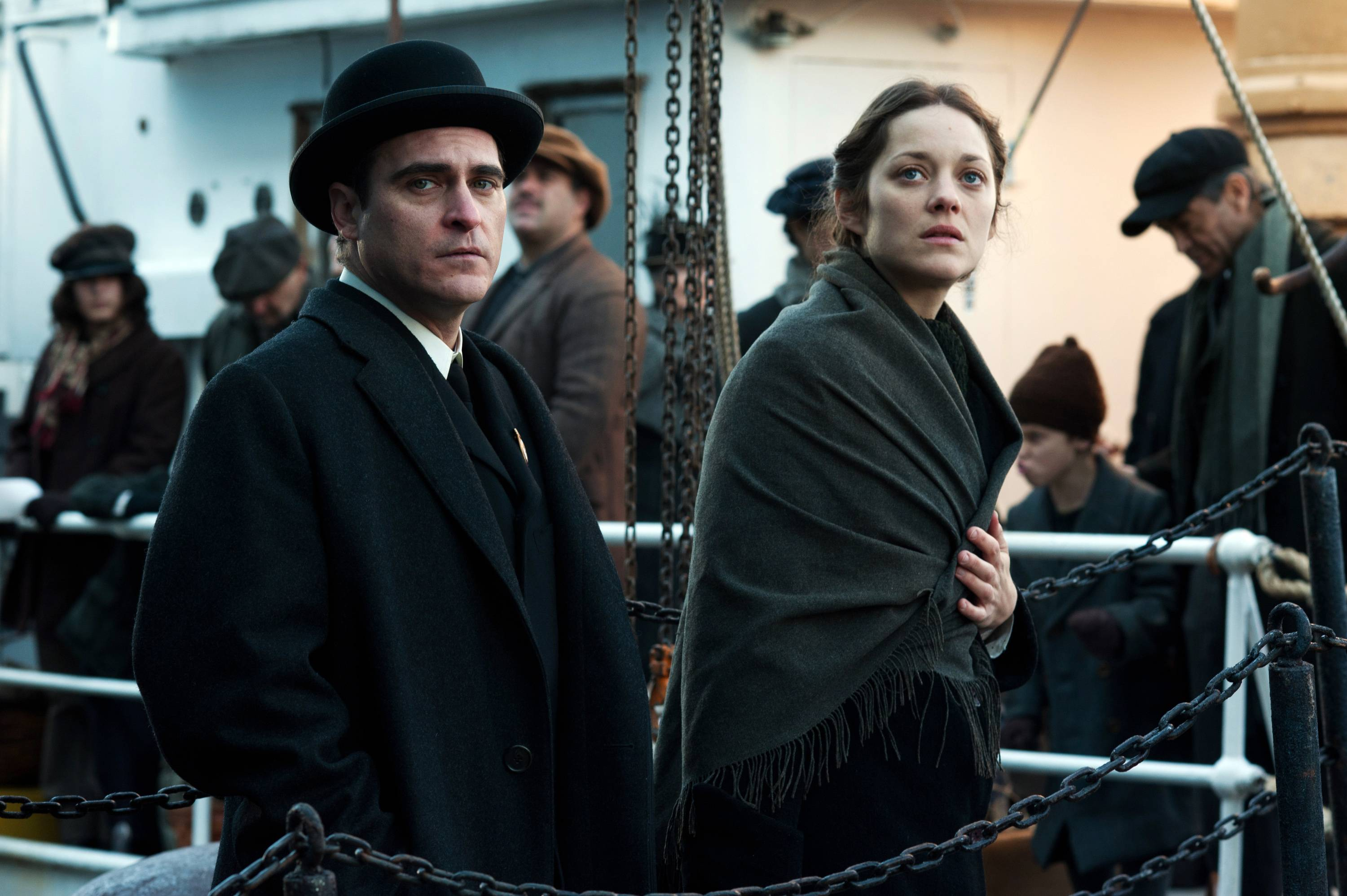 "Bruno (Joaquin Phoenix) helps Ewa (Marion Cotillard) at Ellis Island -- for a price -- in ""The Immigrant."""