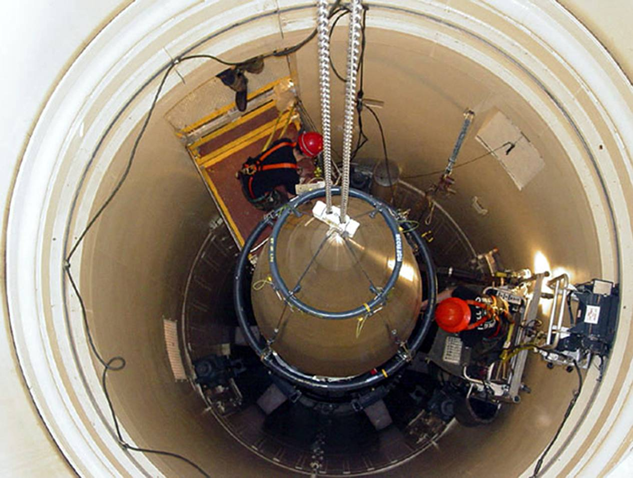In this image released by the U.S. Air Force, a Malmstrom Air Force Base missile maintenance team removes the upper section of an ICBM at a Montana missile site.