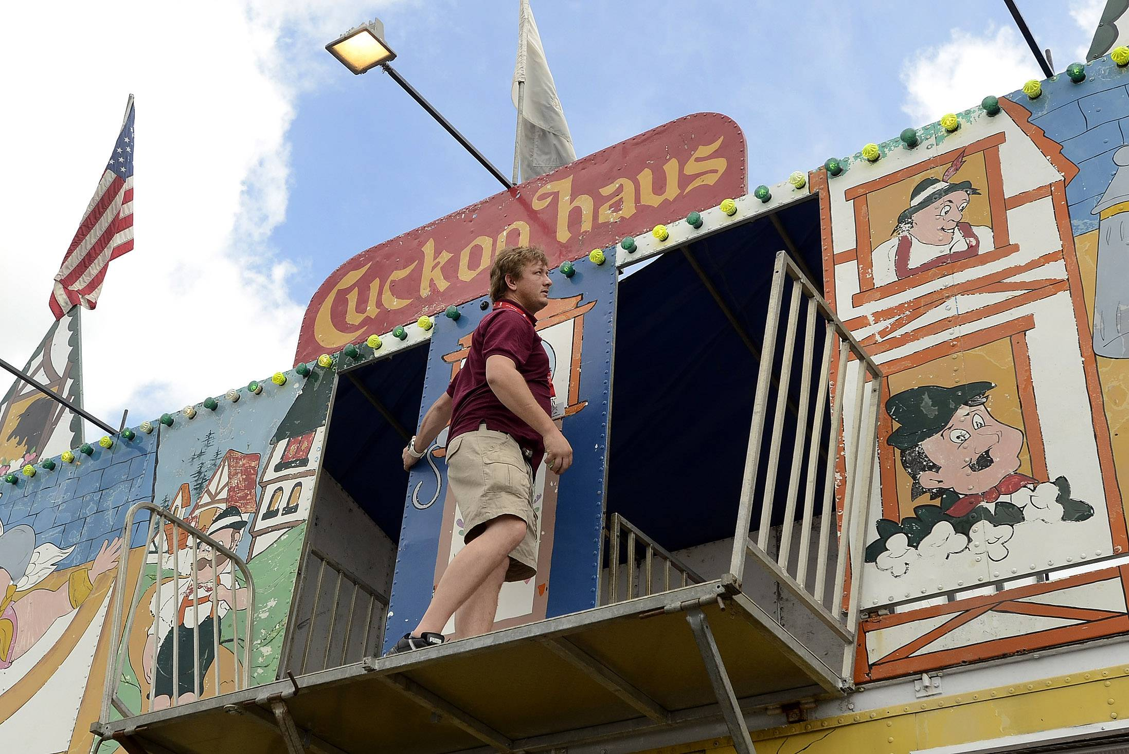 J.P. Coetzer prepares the Cuckoo Haus attraction ahead of Thursday's opening of the Mount Prospect Jaycees Memorial Day Carnival. The event is returning from a three-year hiatus.
