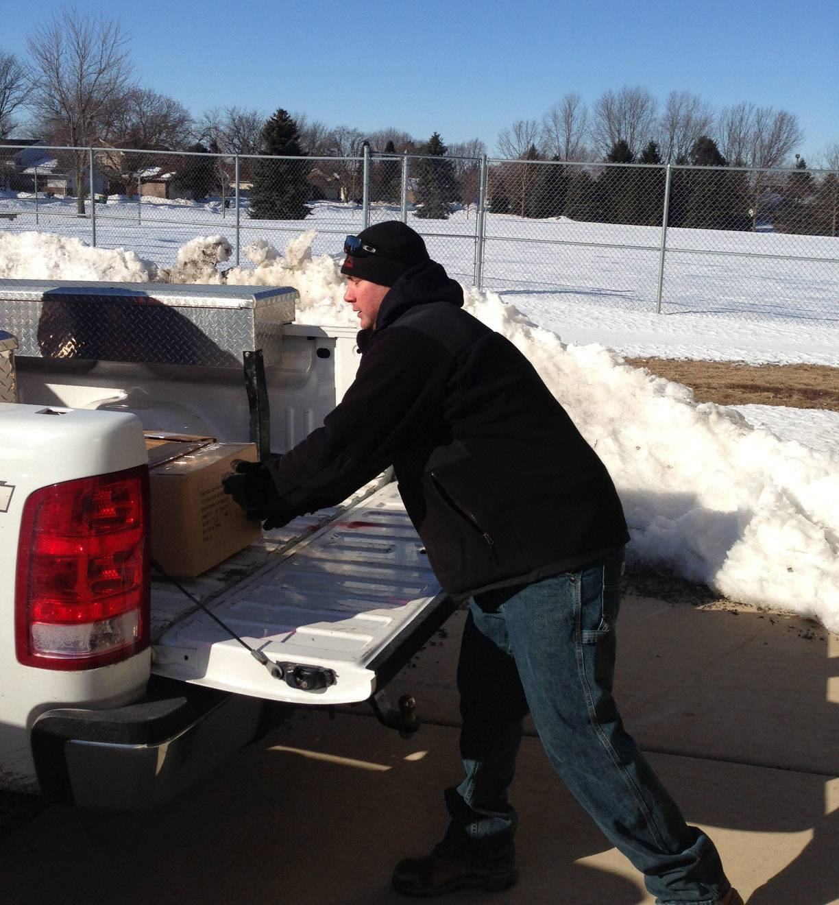 West Aurora School District 129 officials pick up a donation of 2,000 assorted books from the Elburn Lions Club in late February. The books were given to Todd Early Learning Center in Aurora.