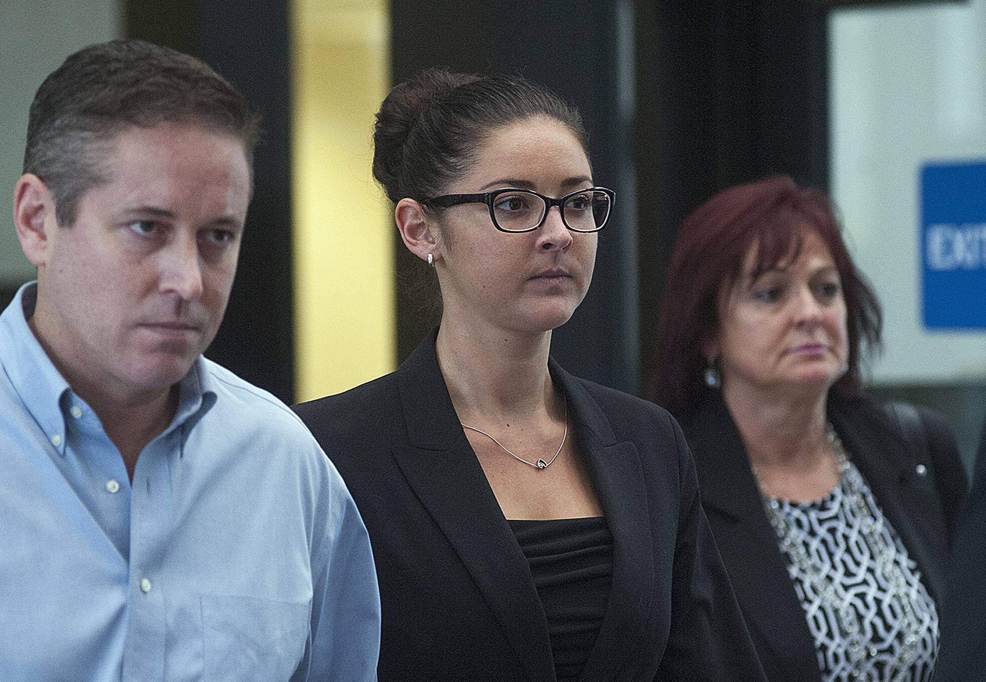Beating victim Stacy Jurich, center, leaves court after testifying against Heriberto Viramontes.