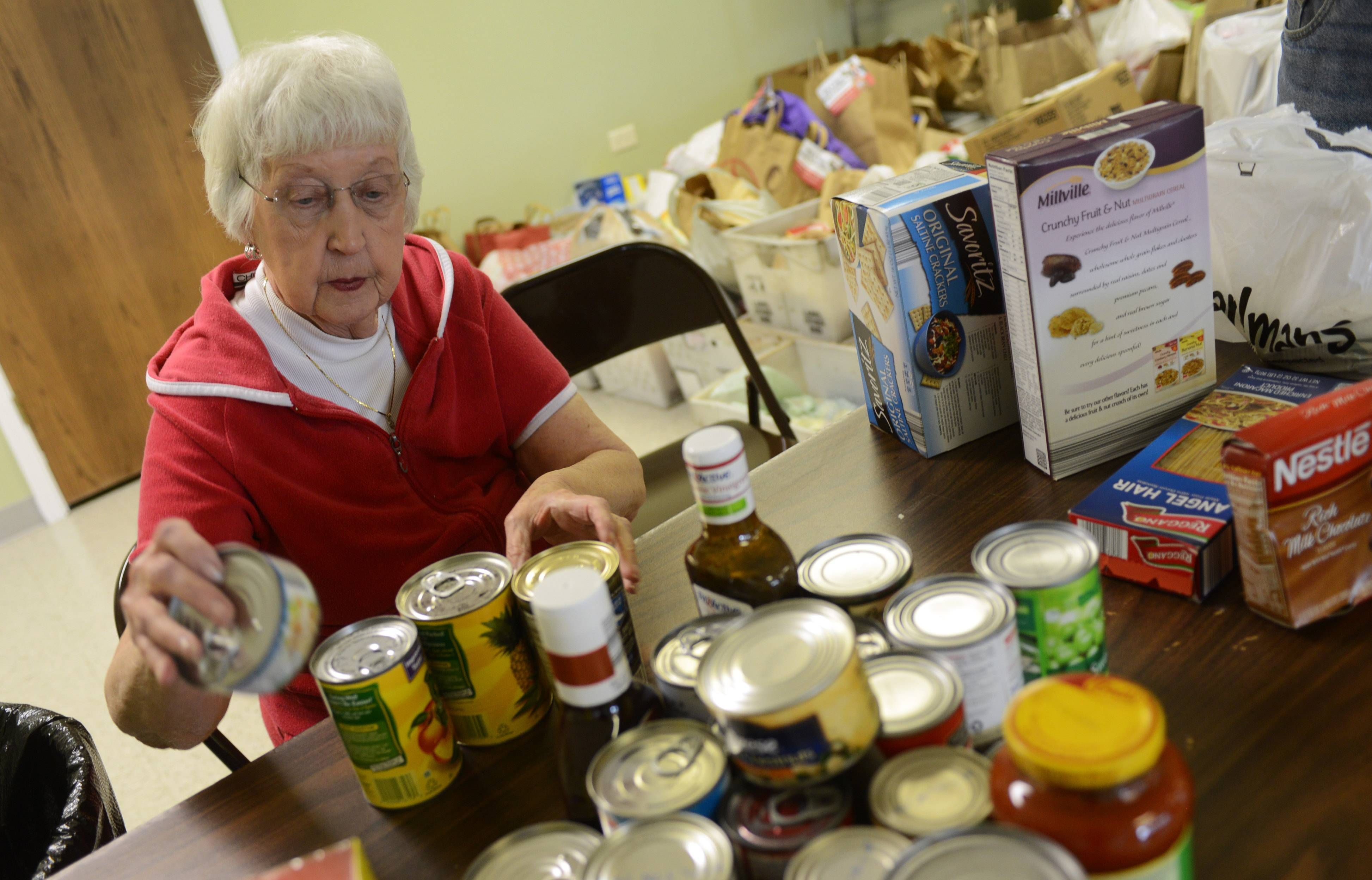 Fremont Township resident Lola Davis sorts food Thursday at the Fremont Township food pantry. A large amount was delivered after a United States Postal Service collection May 10.