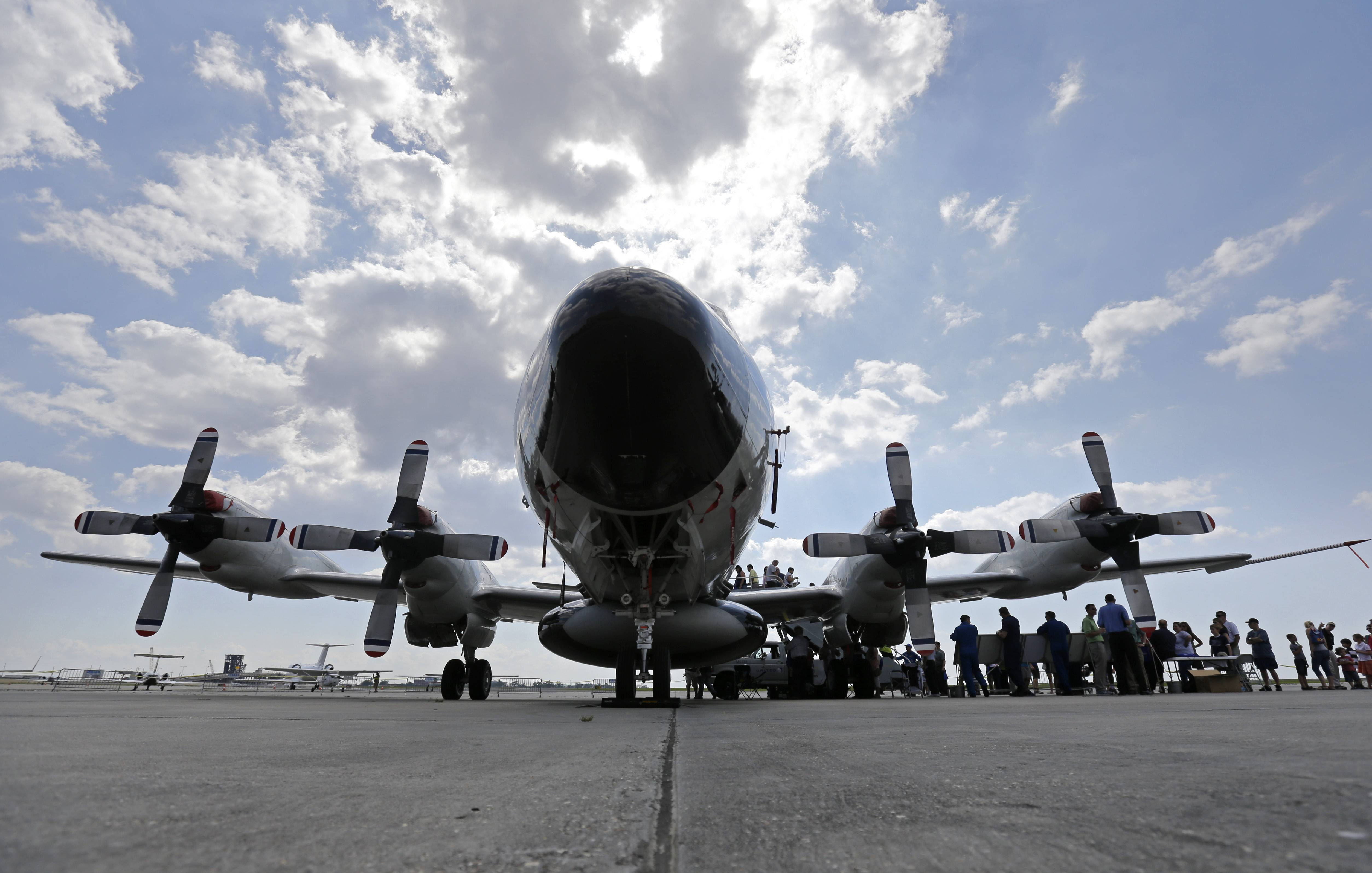 "Visitors line up to tour the National Oceanic and Atmospheric Administration's WP-3D Orion turboprop ""Hurricane Hunter"" at New Orleans Lakefront Airport in New Orleans Wednesday. The aircraft is  used by scientists on research missions to study various elements of a hurricane, flying through the eye of the storm several times each flight."