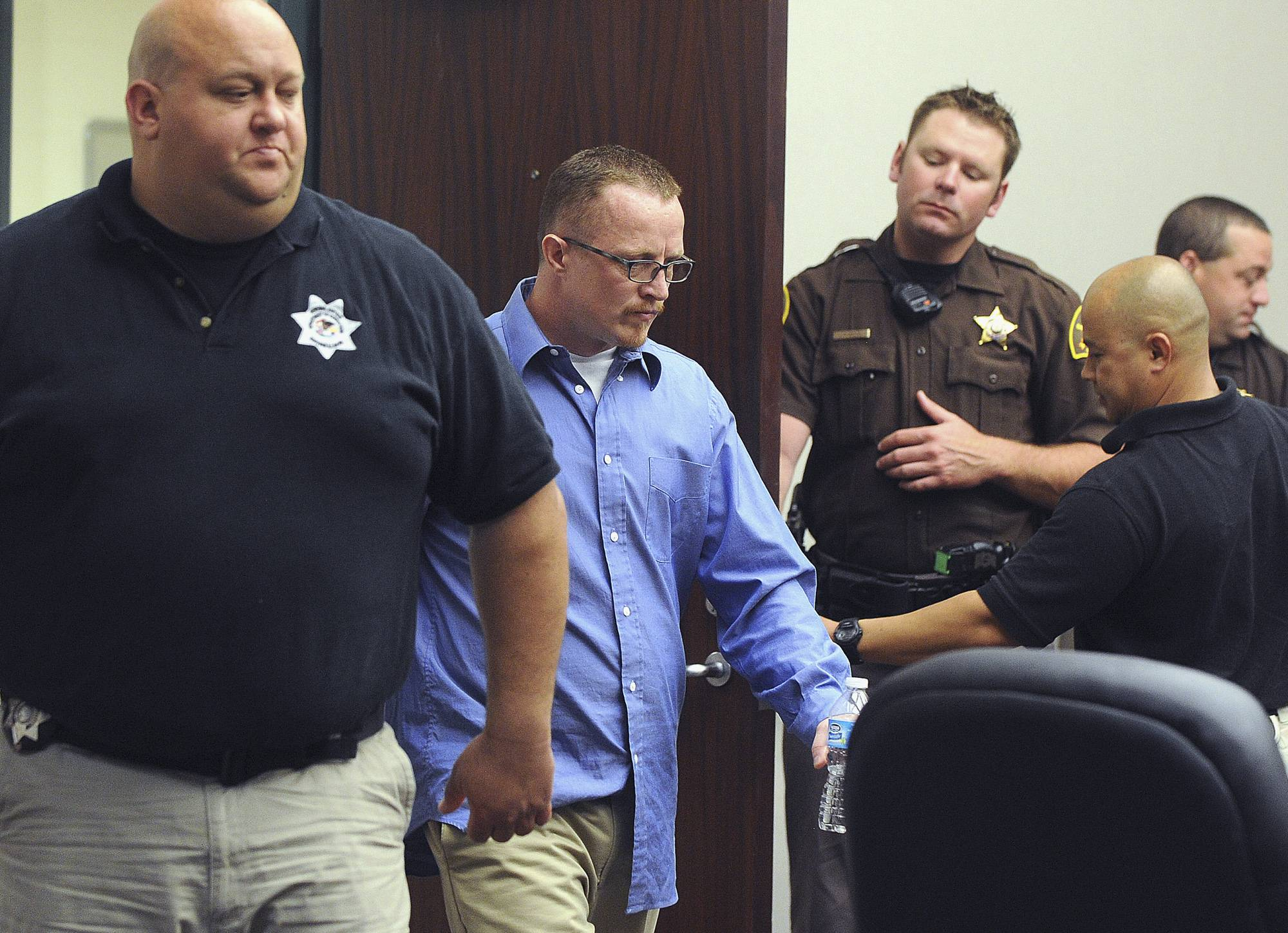 Nicholas Sheley is escorted into the courtroom during the third day of his trial at the Rock Island County Justice Center Wednesday.