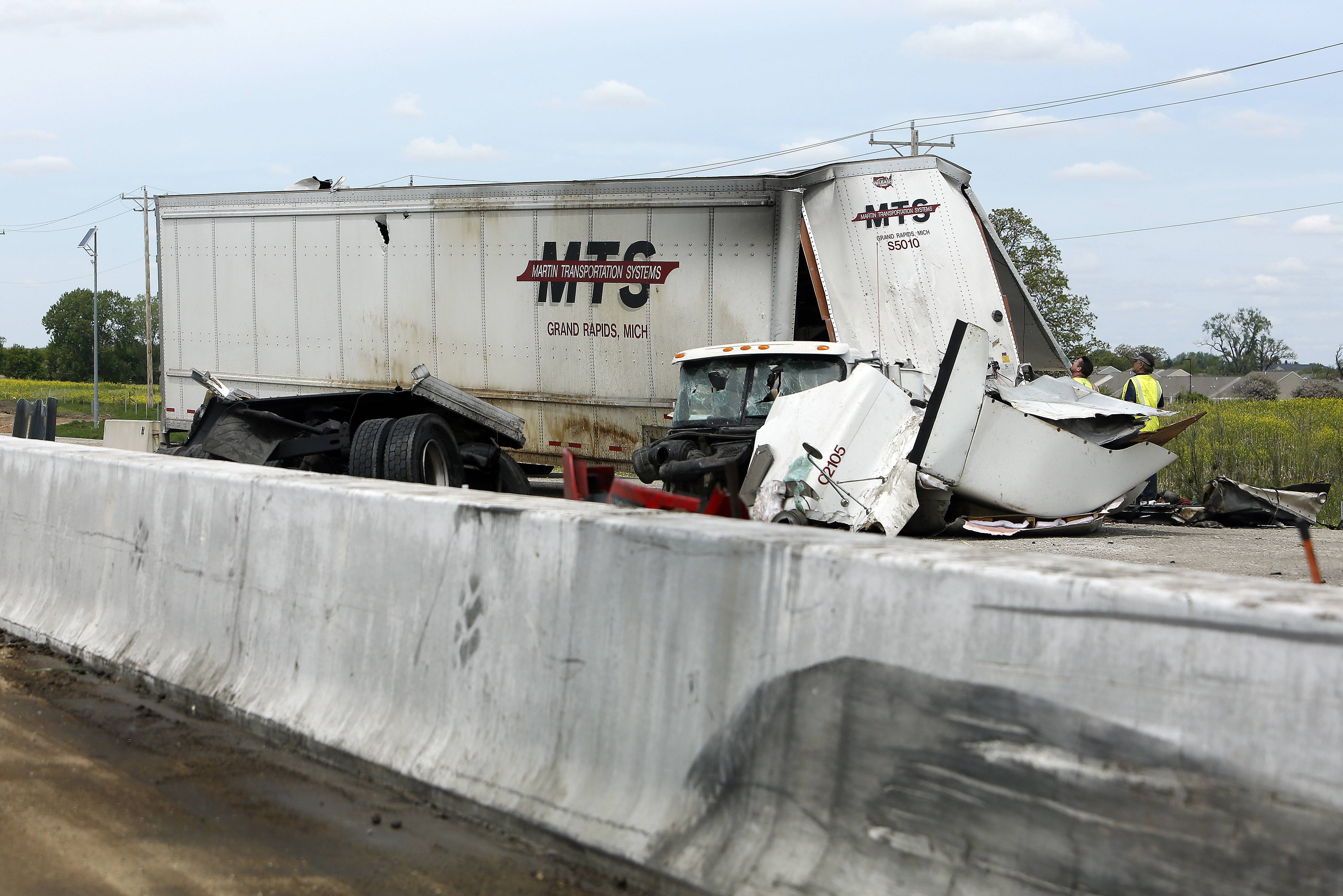 Remains of a truck sit on the shoulder of the westbound lanes of Interstate 90 Thursday.