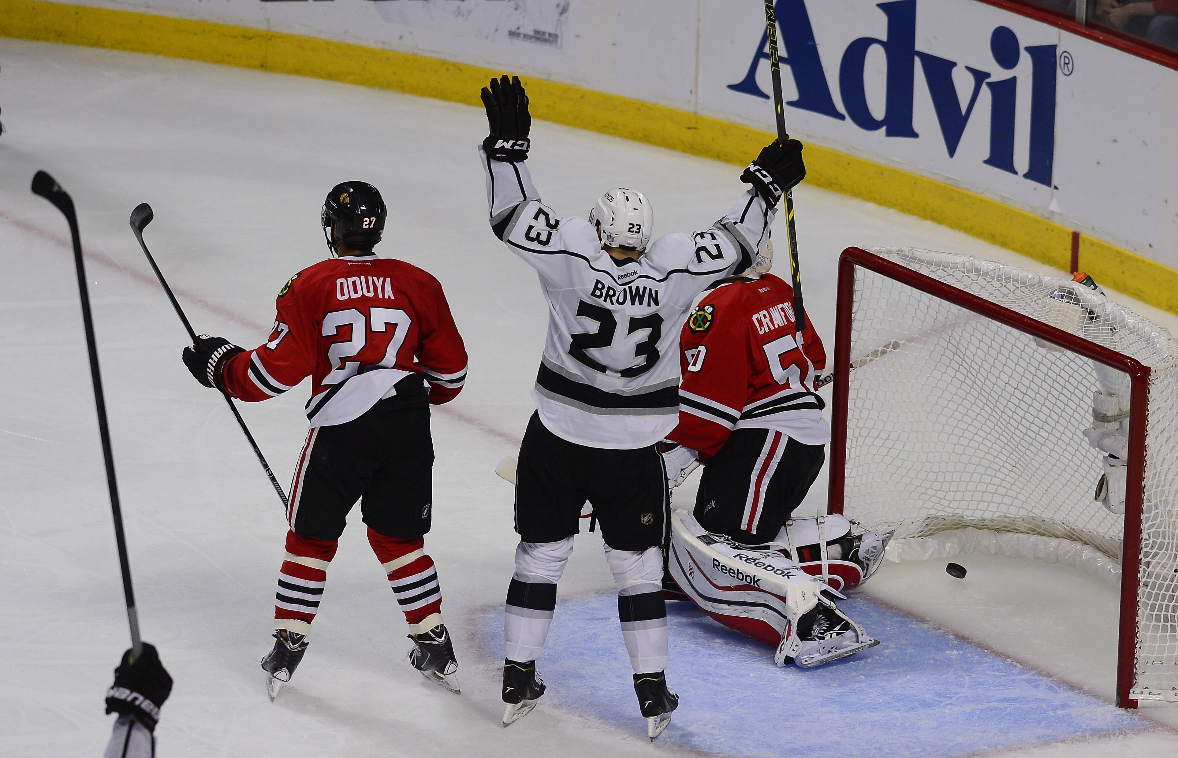 The Los Angeles Kings' Dustin Brown signals goal after his teammate Jake Muzzin scores for the go-ahead goal against the Blackhawks in the third period last night. It was one of many Kings goals to come.