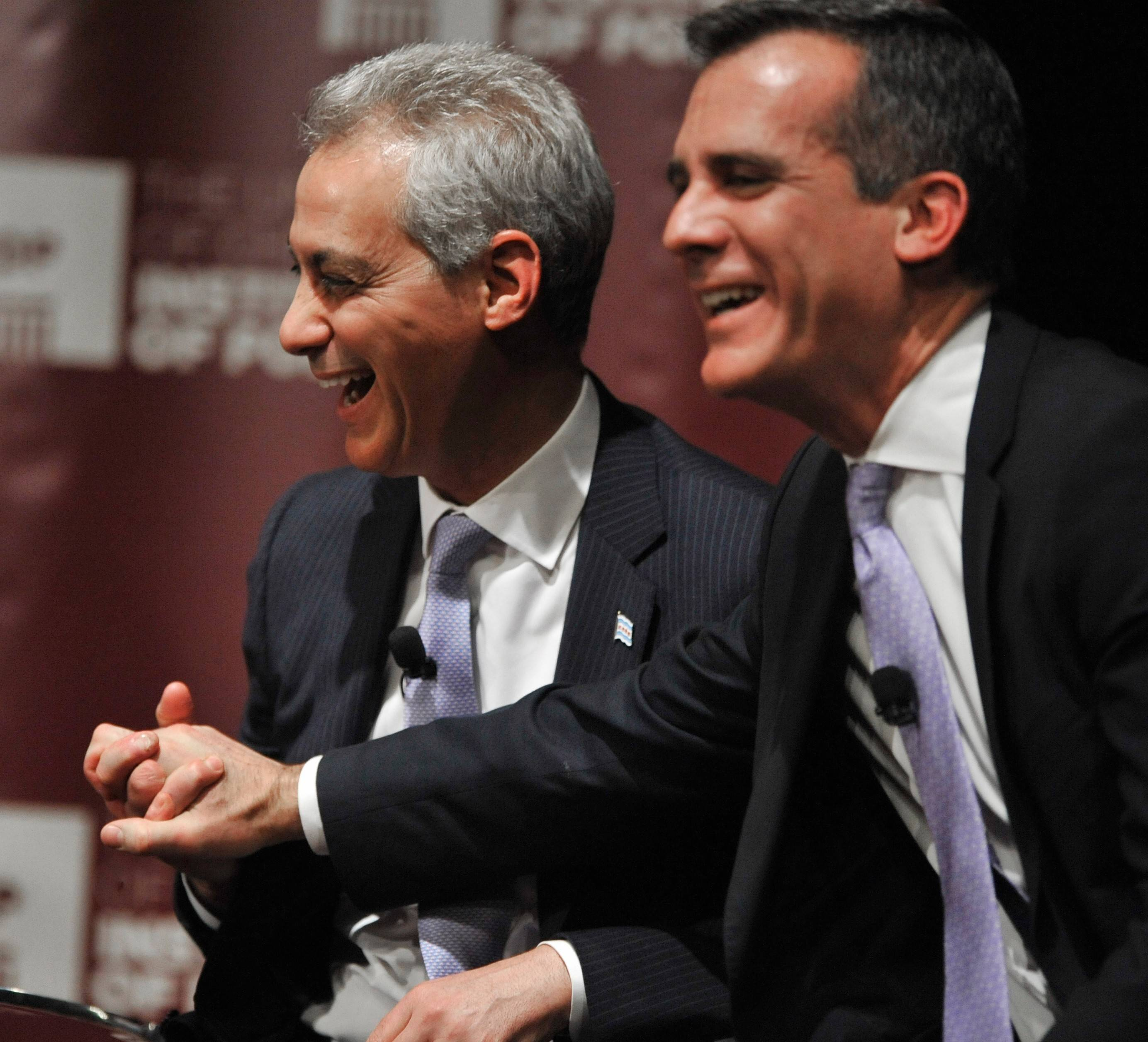 Chicago Mayor Rahm Emanuel, left, jokes with Los Angeles Mayor Eric Garcetti during a March panel discussion about the issues facing the nation's big cities at the University of Chicago. The mayors have a wager on the outcome of the Blackhawks-Kings playoff series.