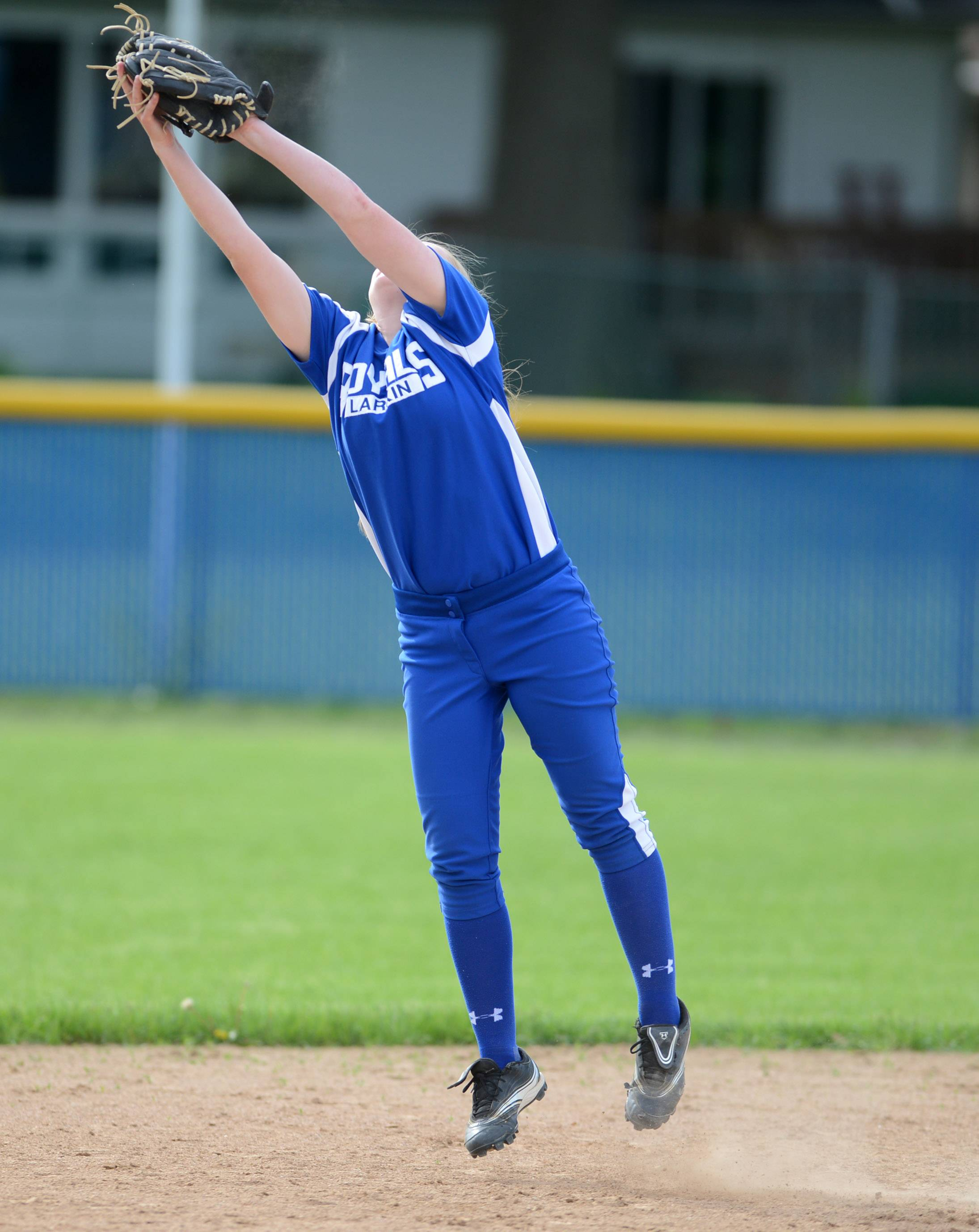 Larkin's Alexandria Bednarski (11) makes a leaping grab of a line drive during Thursday's game at Larkin in Elgin.