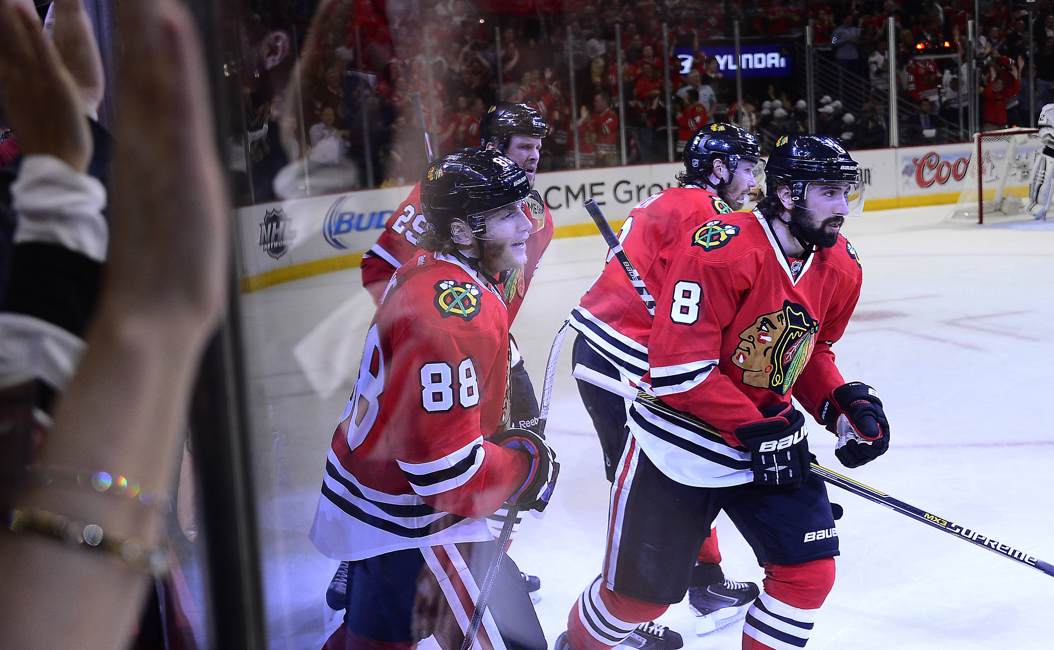 "Fans pound on the glass after Nick Leddy scored the first goal of the game in Wednesday's 6-2 Blackhawks loss. Leddy, a native of Minnesota, said he loves hockey because it ""involves everything."""