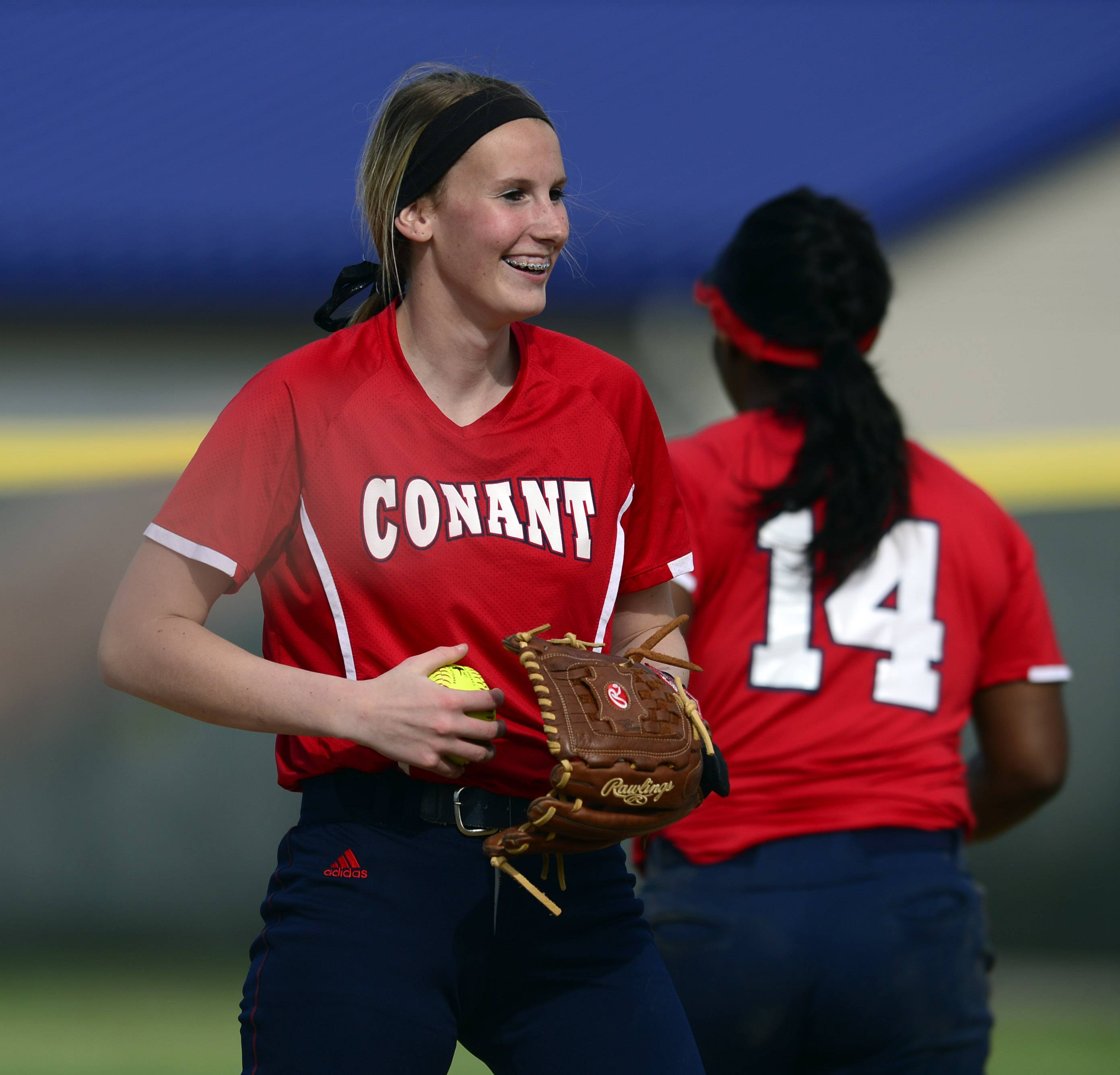 Conant pitcher Kali Schumacher is beaming with confidence early on in the Mid-Suburban League championship softball game against Buffalo Grove at Conant on Thursday.