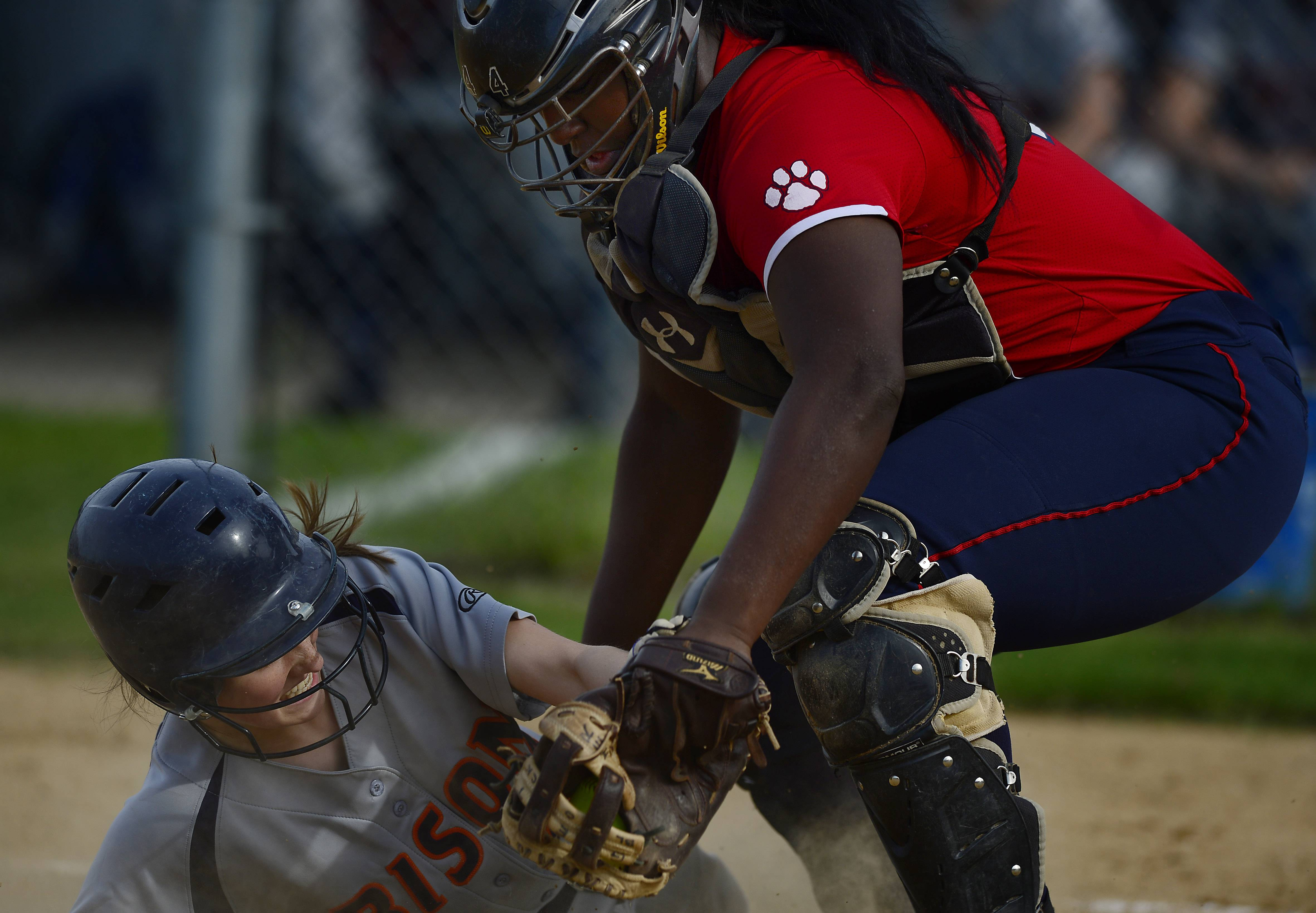 Conant catcher Dream Aaron blocks the plate and prevents Buffalo Grove's Cassie May from scoring in the third inning at the Mid-Suburban League championship softball game at Conant on Thursday.