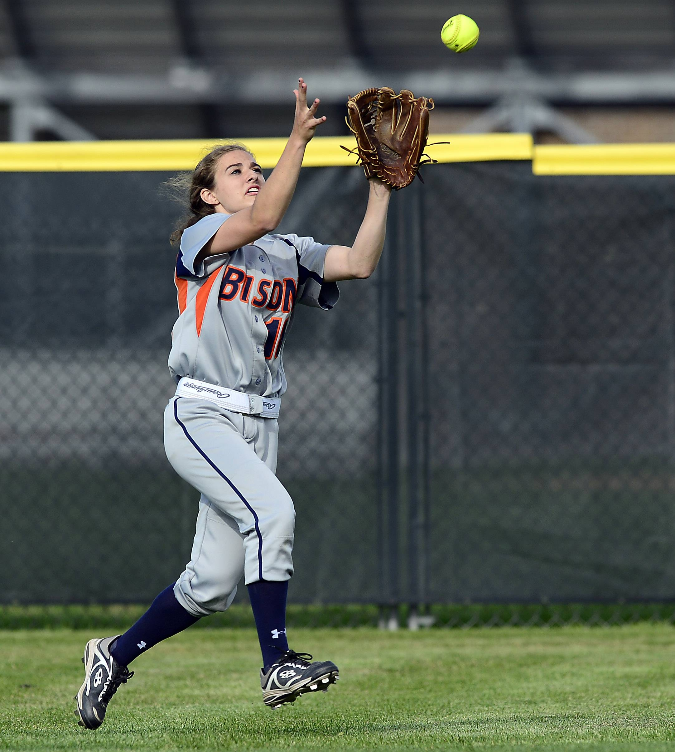 Buffalo Grove's Caitlin Catino makes the catch off the bat of Conant's Rachel O'Malley in the bottom of the third inning in the Mid-Suburban League championship softball game at Conant on Thursday.