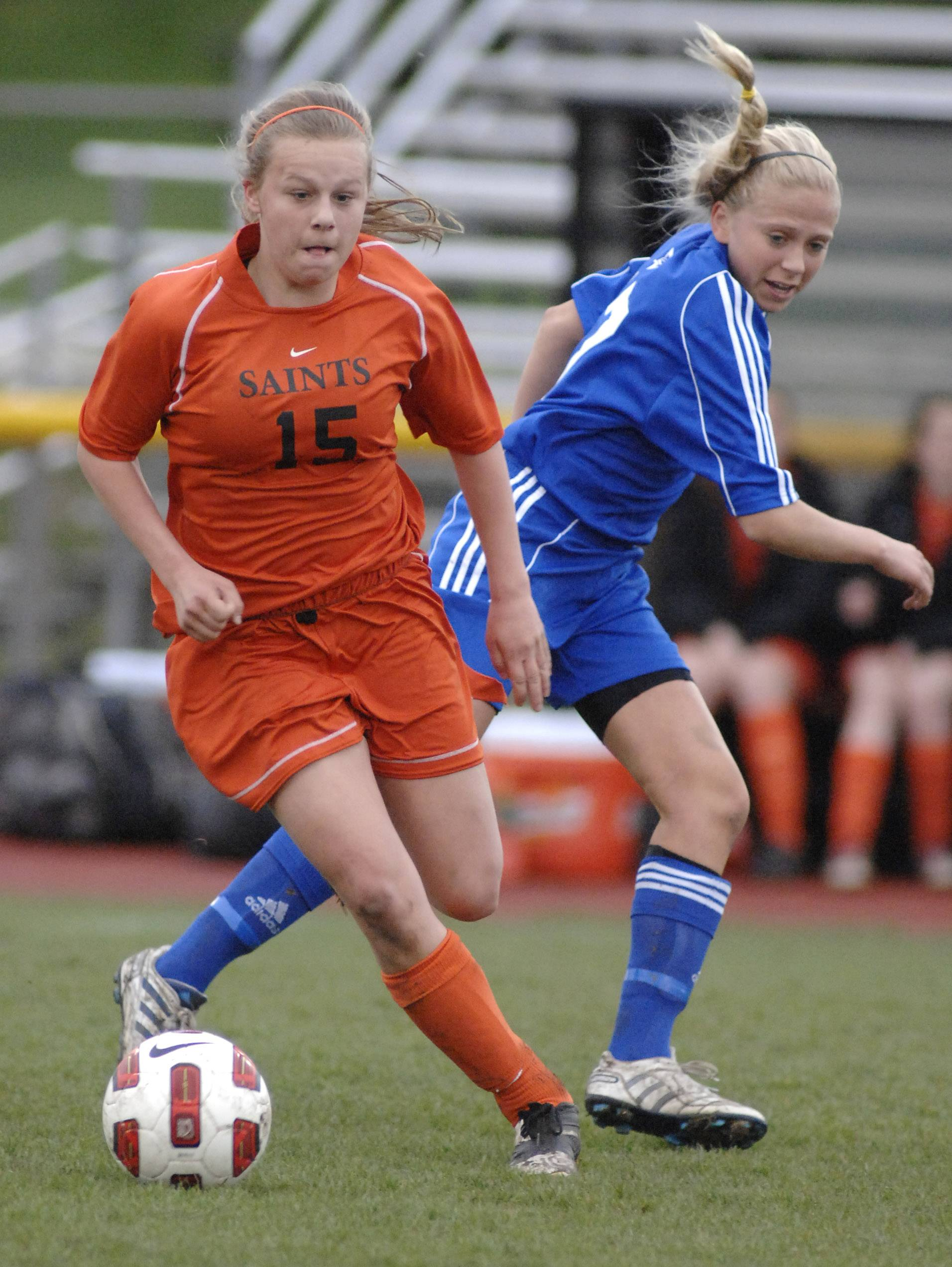 Laura Stoecker/lstoecker@dailyherald.com ¬ St. Charles East's Amanda Hilton and St. Charles North's Kelly Manski in the first half on Tuesday, April 26.