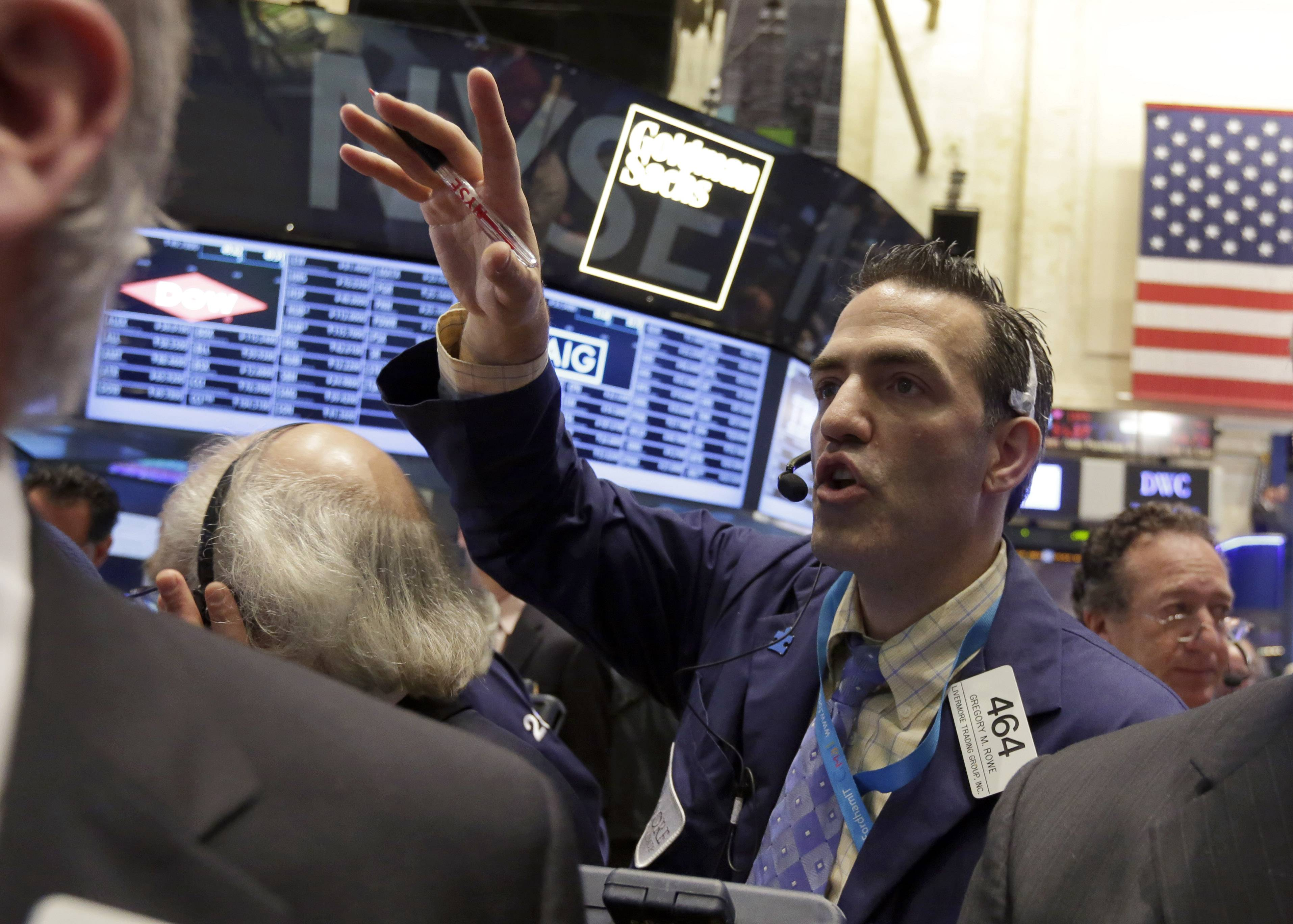 Trader Gregory Rowe works Friday on the floor of the New York Stock Exchange. Stocks inched higher in quiet trading ahead of the Memorial Day weekend.