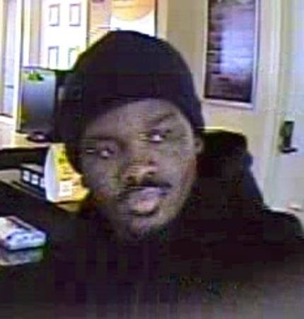 A surveillance image shows bank robbery suspect William Rozelle of North Chicago, who was charged Friday by federal authorities.