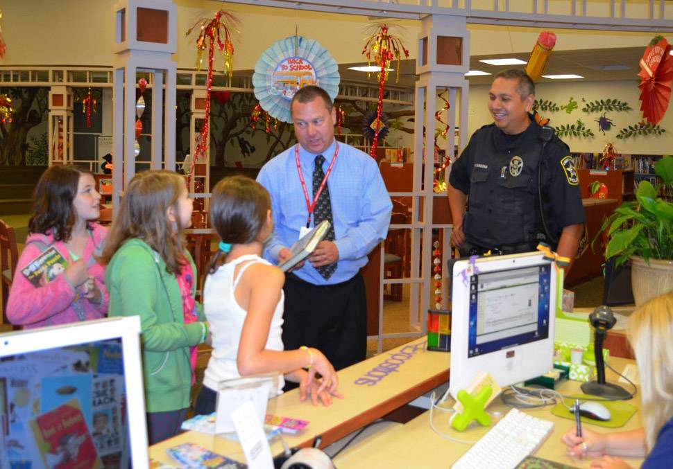 Libertyville Police Officer Alex Cardona, right, and Andy Elbert, assistant principal at Butterfield School in Libertyville, visit with students. A greater police presence is part of continuing security upgrades at Libertyville District 70 schools, officials said.