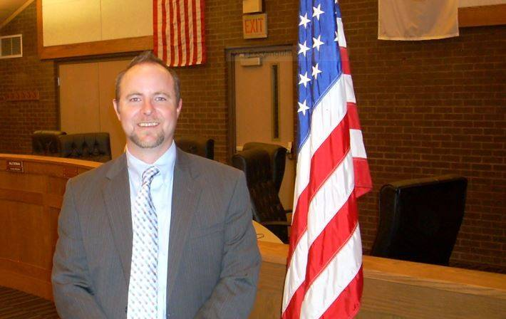 Mark Carroll was sworn in as a village trustee Monday. He will serve through April, filling out the term of Ryan Lambert, who resigned.