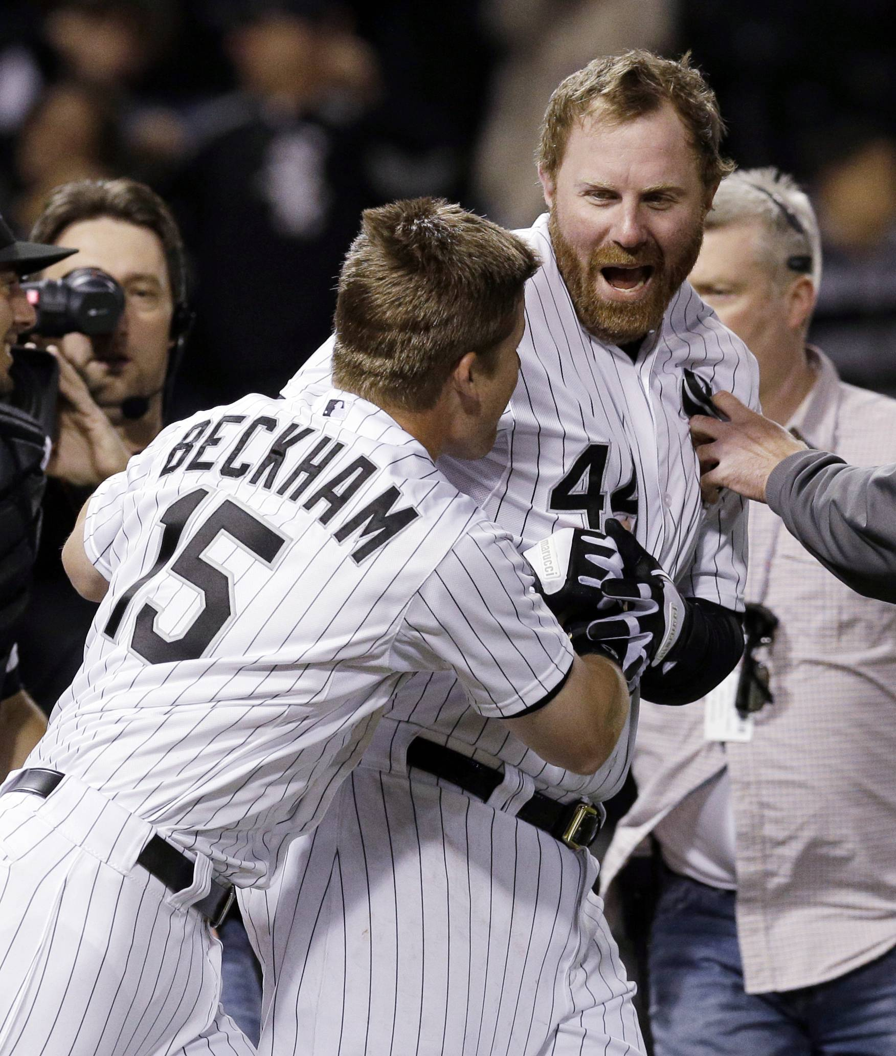 Adam Dunn, right, celebrates with Gordon Beckham after hitting the game-winning two-run home run against the New York Yankees during the ninth inning of a baseball game in Chicago on Friday, May 23, 2014. The White Sox won 6-5. (AP Photo/Nam Y. Huh)