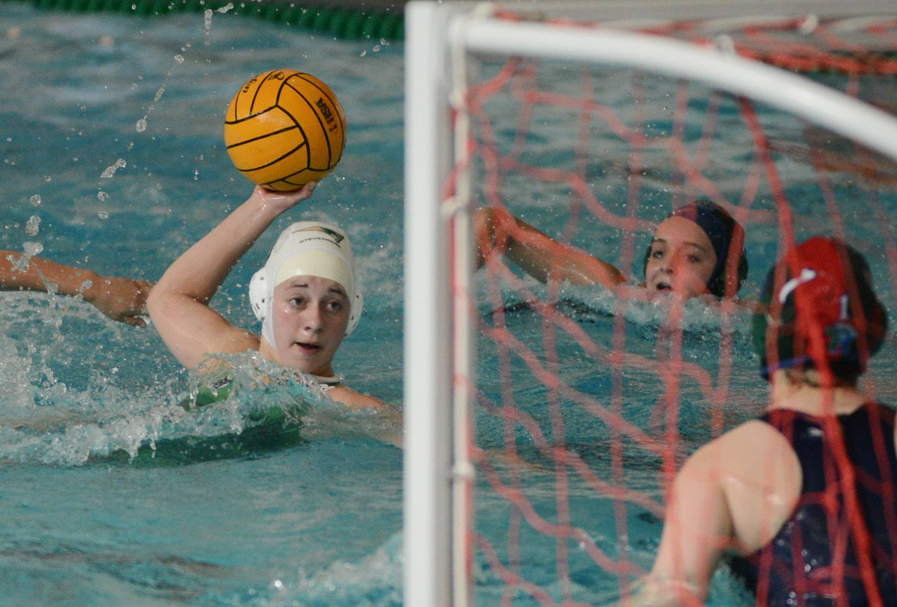 Stevenson's Melissa Gartenberg, left, zeroes in on the goal before scoring against New Trier during Friday's state water polo quarterfinal match in Lincolnshire.