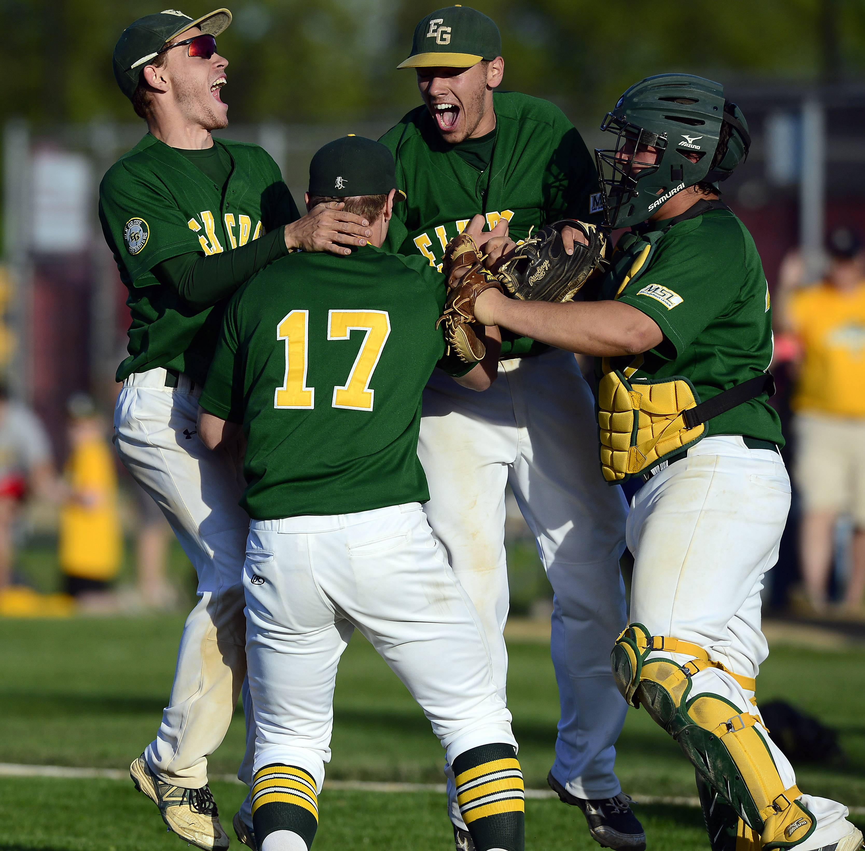 Elk Grove's Adam O'Malley (17) celebrates with his teammates after the Grens beat Schaumburg 4-0 in the Mid-Suburban League championship game at Schaumburg on Friday.