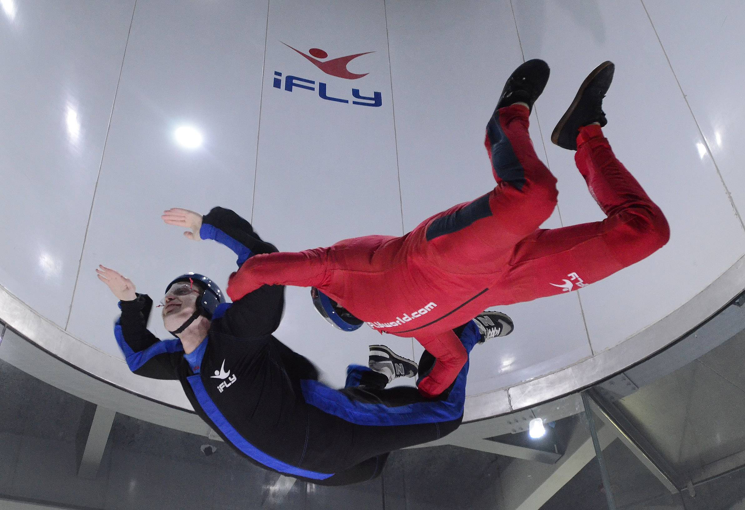 Daily Herald reporter Chris Placek is guided by instructor Gabriel Roth at the new iFLY indoor sky diving experience in Rosemont's entertainment district.