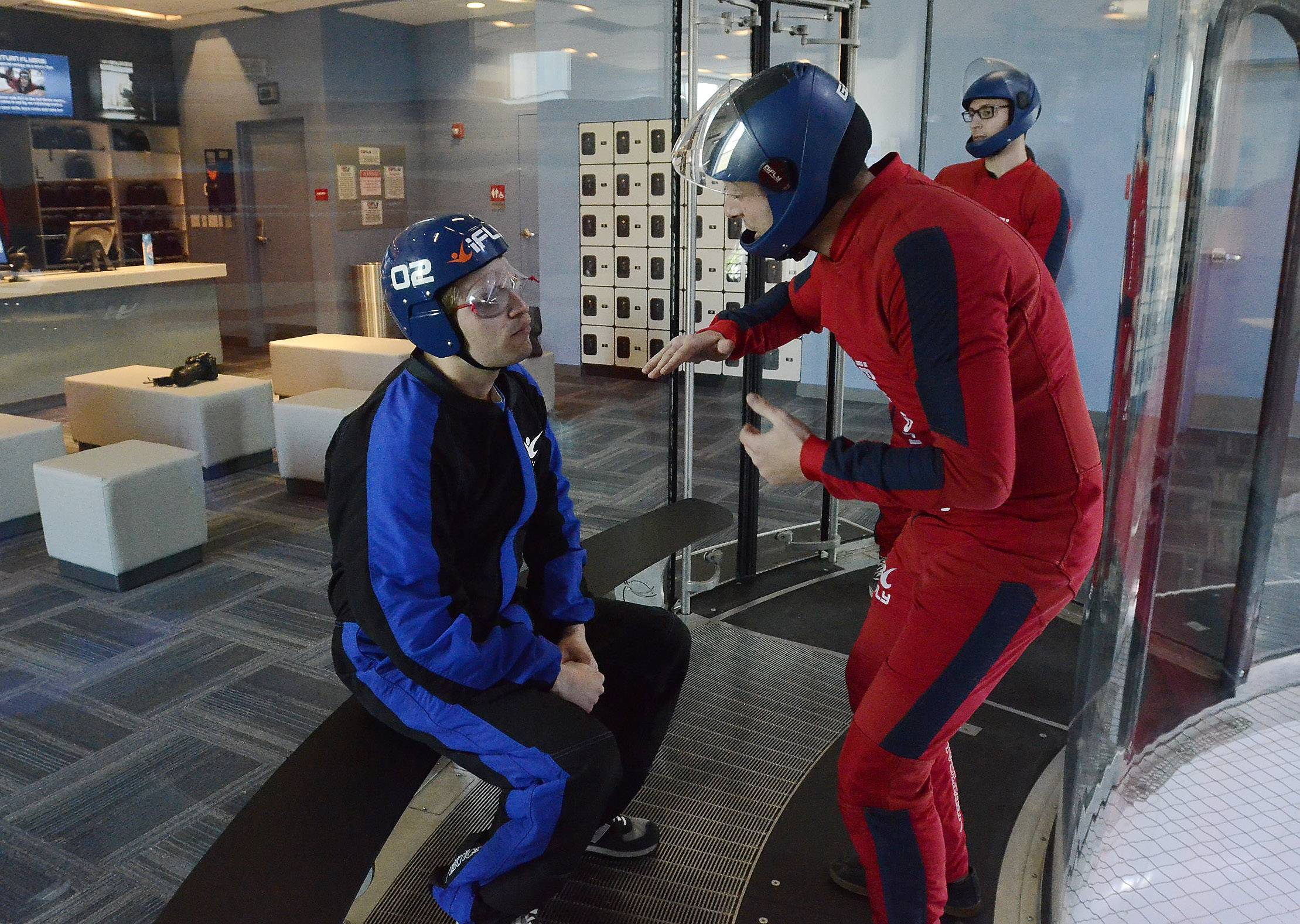 Daily Herald reporter Chris Placek gets some last-minute advice from instructor Gabriel Roth before entering the flight chamber at iFLY in Rosemont.