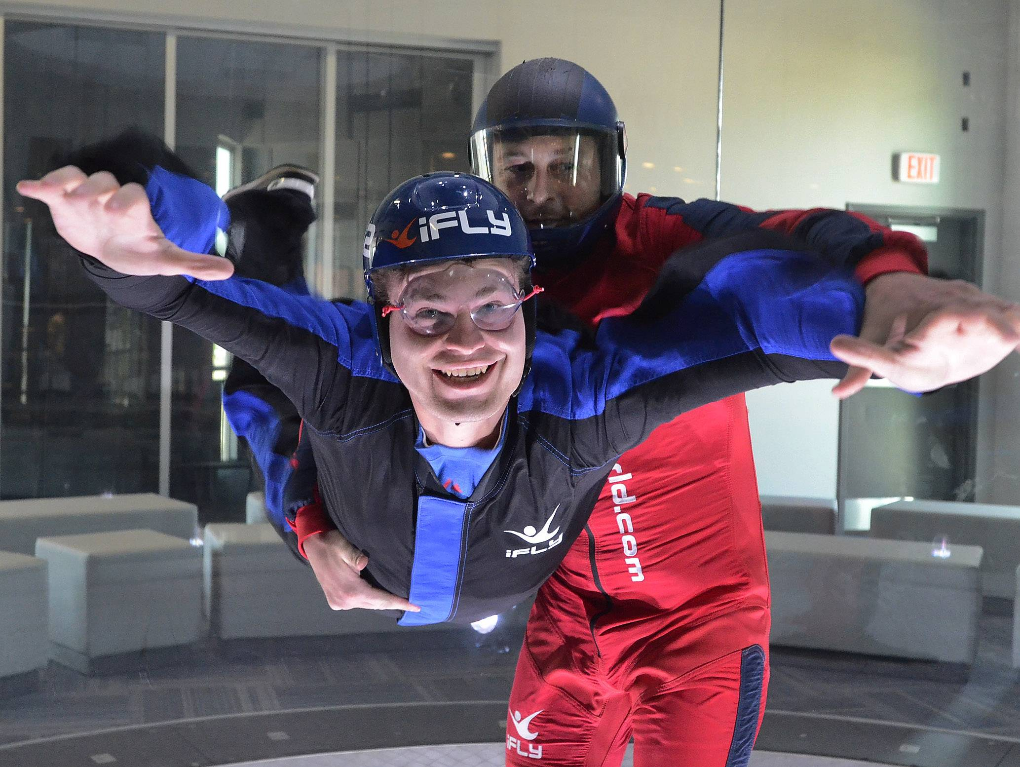 Daily Herald reporter Chris Placek takes flight, with the help of instructor Gabriel Roth, at the new iFLY indoor sky diving experience in Rosemont.