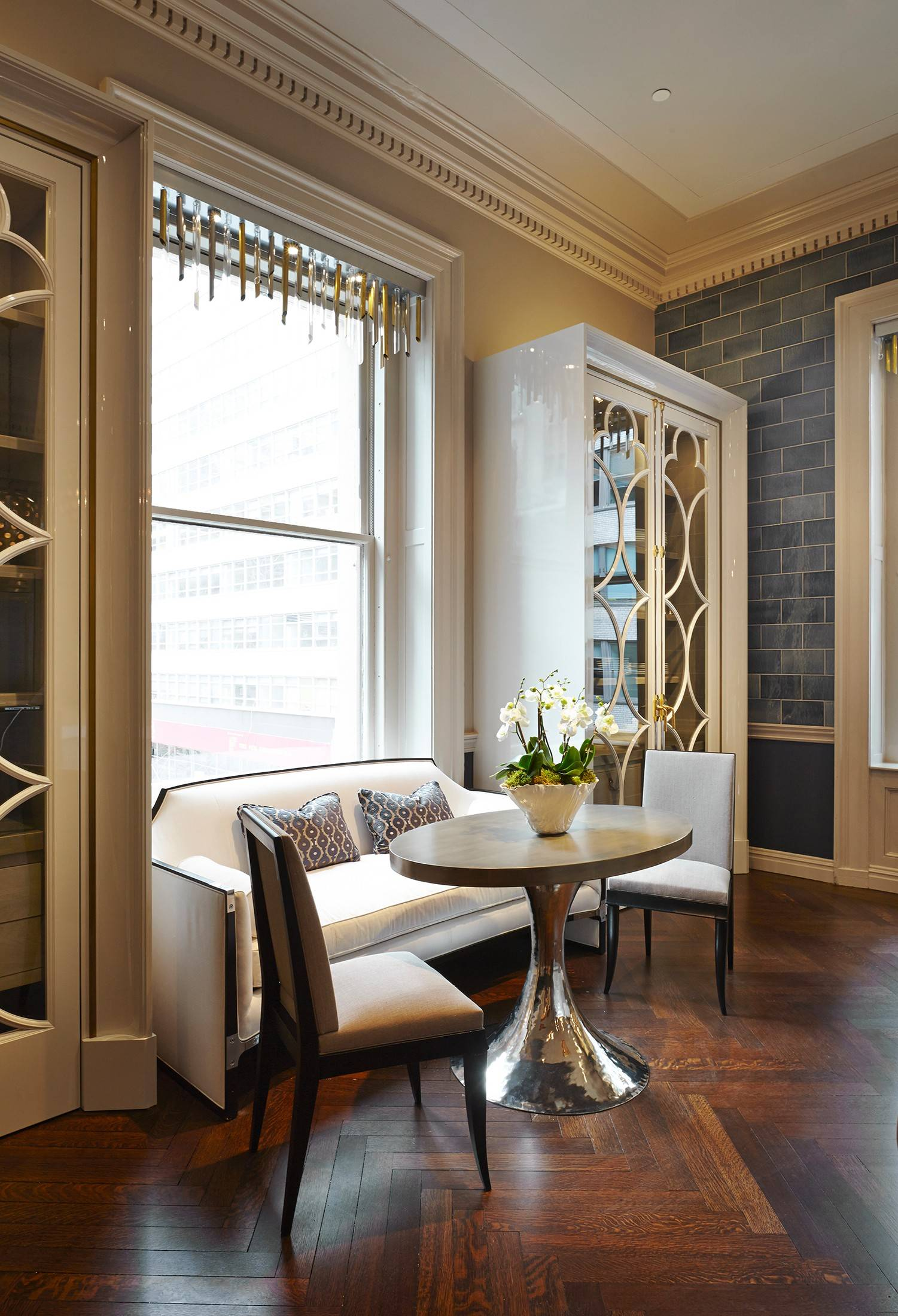 Room 13 of the Kips Bay Show House 2014 in New York is Matthew Quinn's glamorous kitchen. It has nine-foot-tall glass-front silvery gray cabinets whose quatrefoil detail was taken from the windows at St. Patrick's Cathedral.