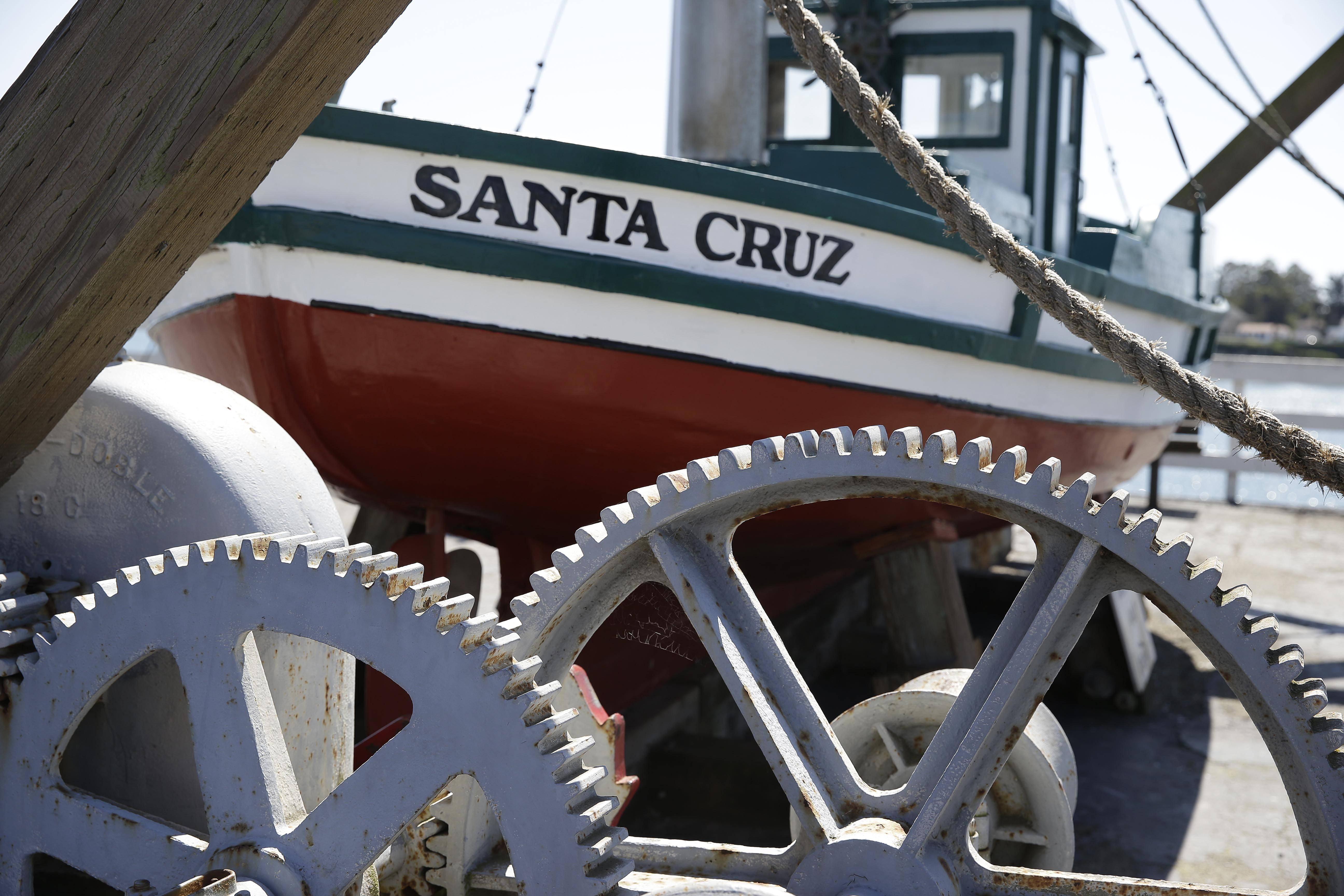 An old felucca fishing boat sits by a boat lift on the Santa Cruz Wharf in Santa Cruz, Calif. The wharf is one of several attractions that can be enjoyed for free in this seaside city.